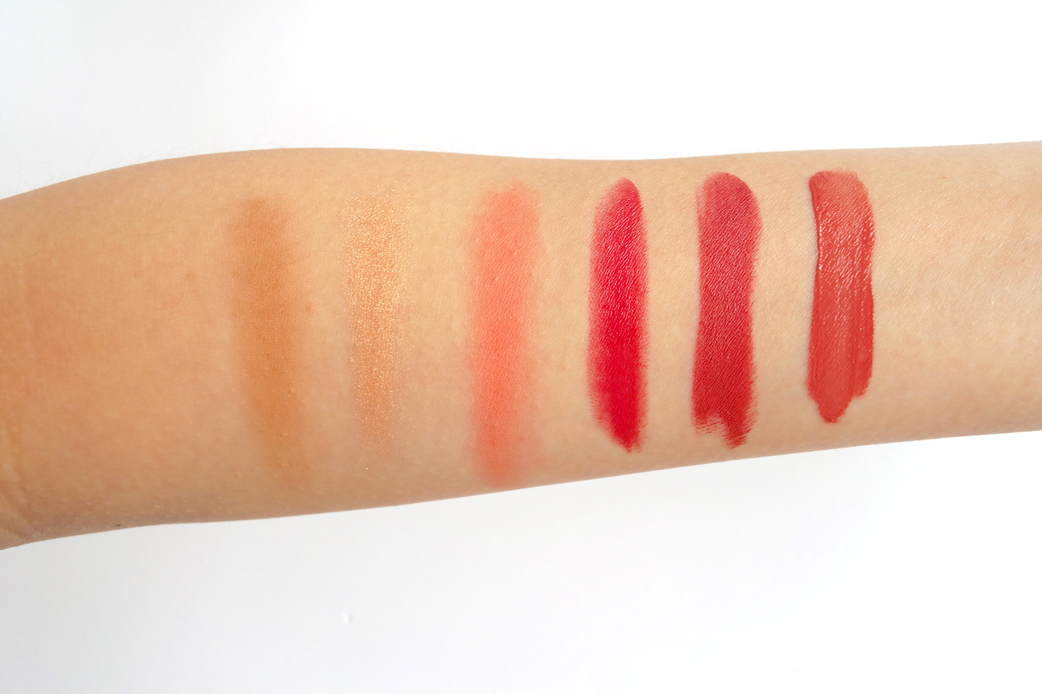 Swatches, from left: Contour, Blush and Highlight Palette in Sun Kissed (contour, highlight, blush), Velvet Lip Cream in Flirty, All-Day Intense Matte Lipstick in Charming, Long-Lasting Liquid Matte Lipstick in Sophisticated