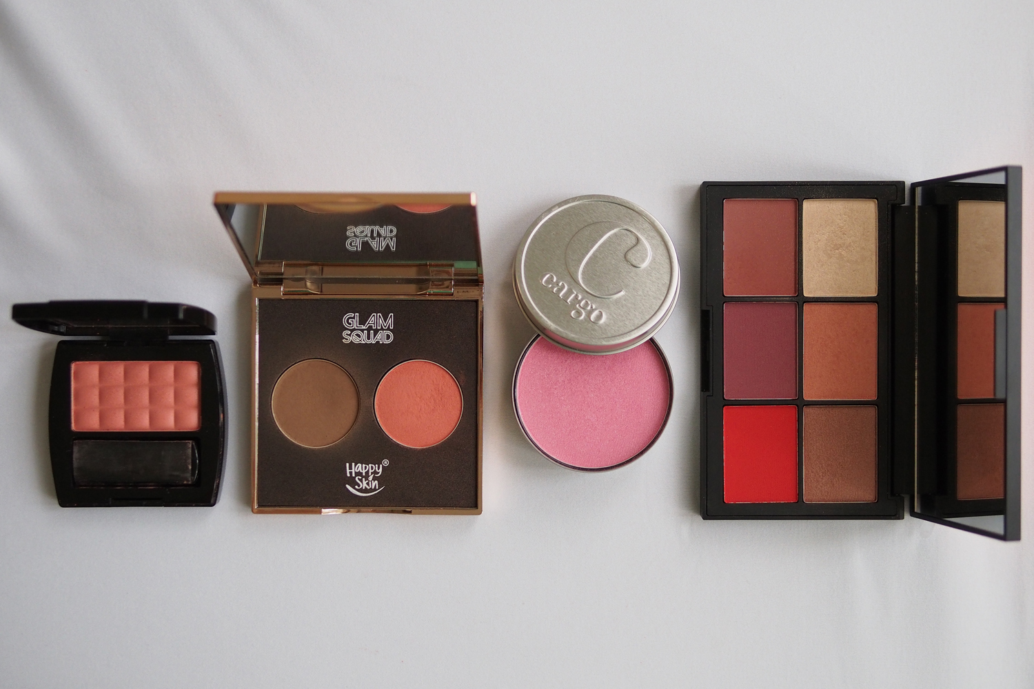 From left:Features & Shades Powder Blush in Georgia Peach (~P98.75/g), Happy Skin Glam Squad Contour & Color (~P215.33/g), Cargo Water Resistant Blush in Ibiza ~(P113.64/g), Nars Blush in Exhibit A (~P354/g)
