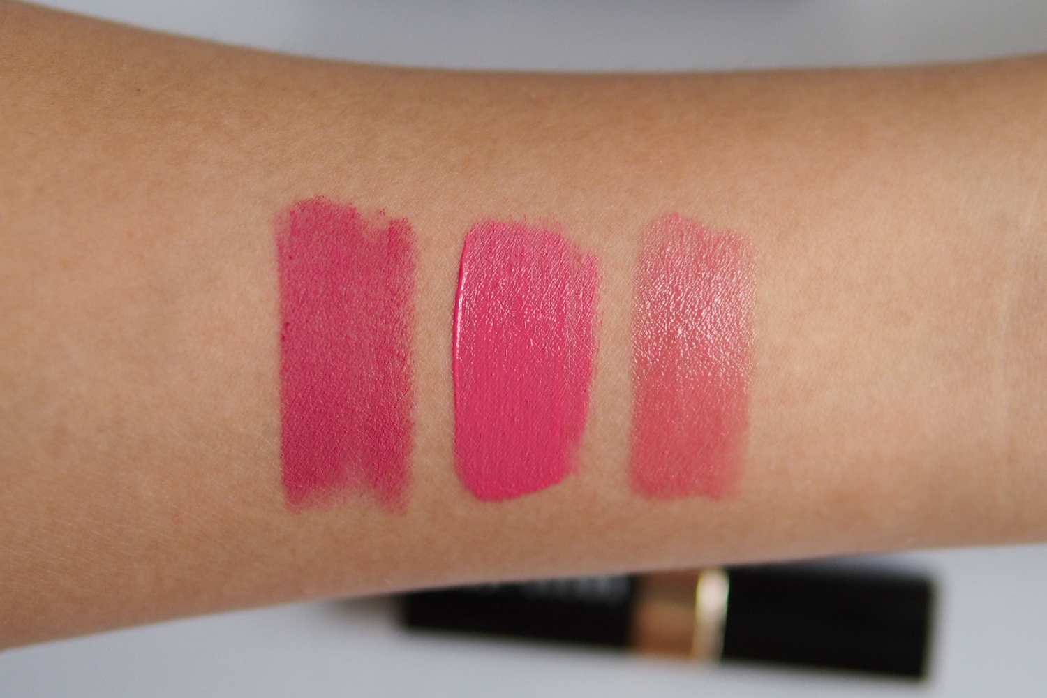 From left: Avon True Color Perfectly Matte Lipstick in  Adoring Love , Ofra Long Lasting Liquid Lipstick in  Hollywood , Bobbi Brown Nourishing Lip Color in  Island Pink
