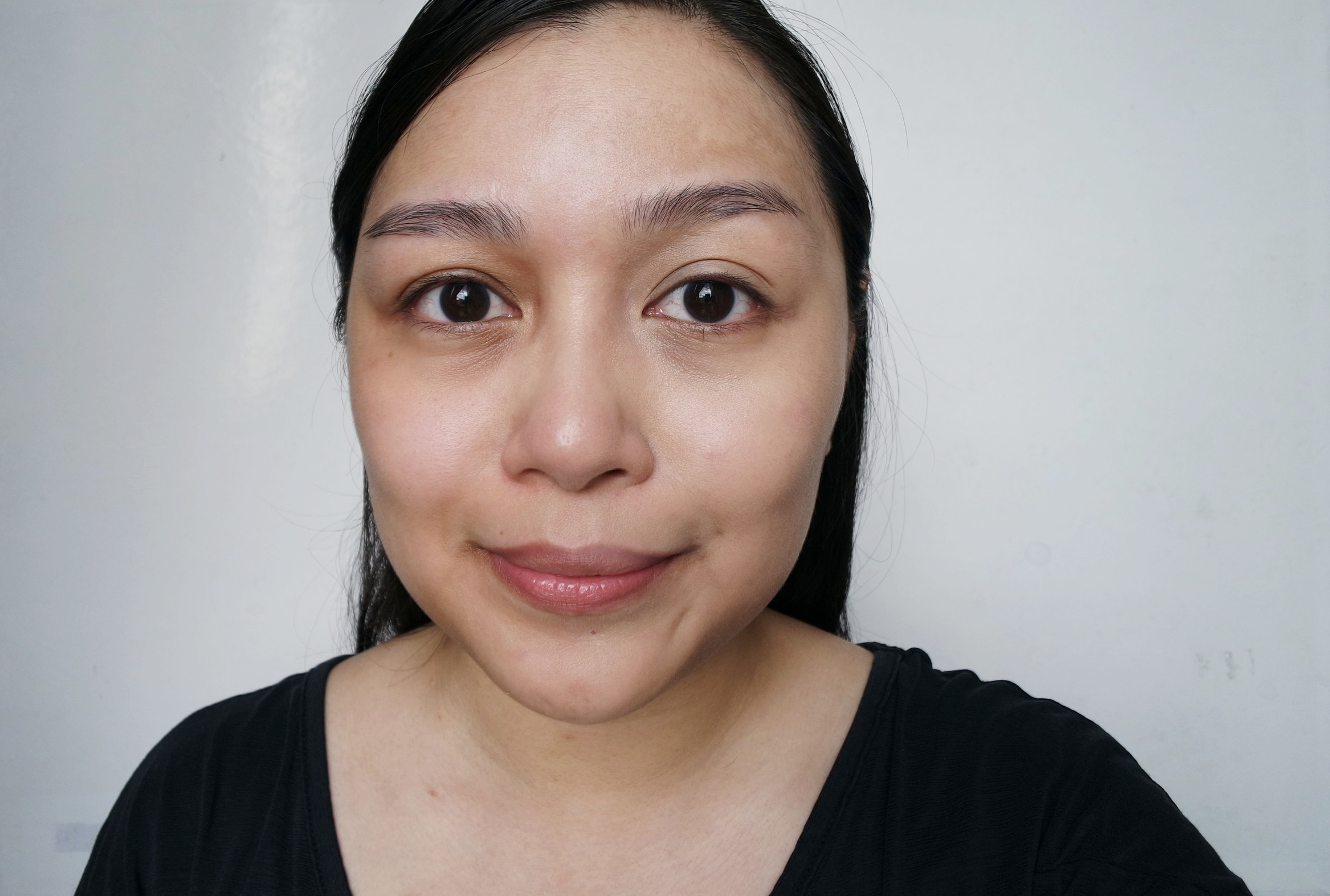 Wearing foundation only on the right side! That part of my face looks much brighter and lifted, without the obvious appearance of makeup.