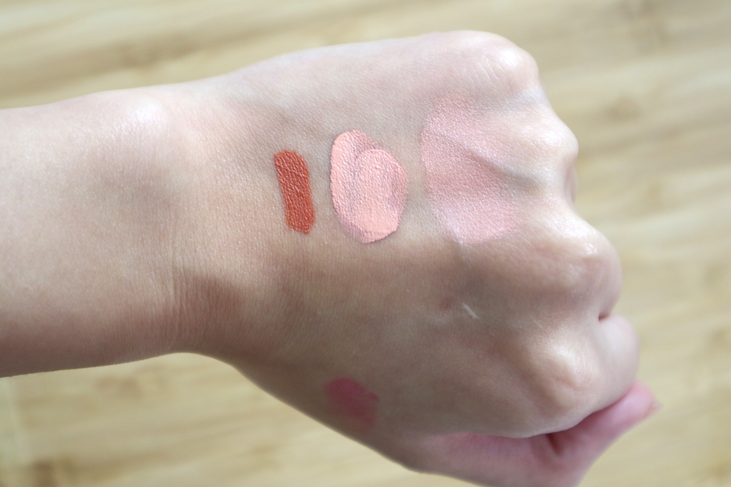 Swatches, from left: LA Girl HD Pro Conceal in Orange, Makeup World Cover Up Corrector in Orange, and Club Clio Kill Cover Pro Artist Liquid Corrector