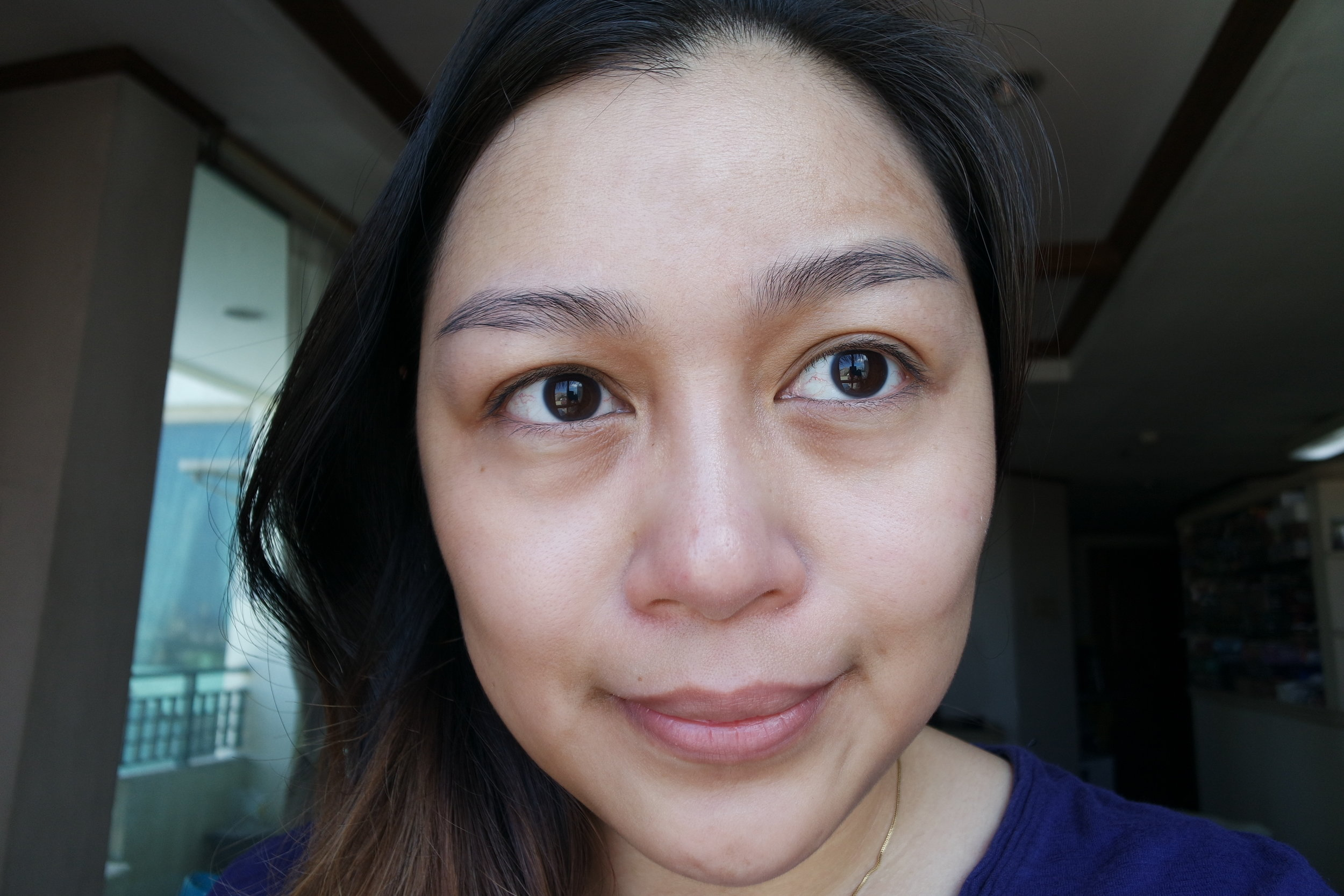 Bare face, wearing the Face Sunblock on the left and the Kids Sunblock on the right