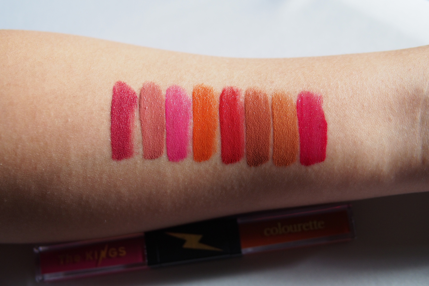 Swatches, from left:  Dualitint 1 in Love and Light, Dualitint 2 in Resting Beach Face (RBF) and No Furs Given (NFG), Dualitint 3 in Supercharged and Racewife, and Dualitint 4 in the metallics Happy Hour and Morning After