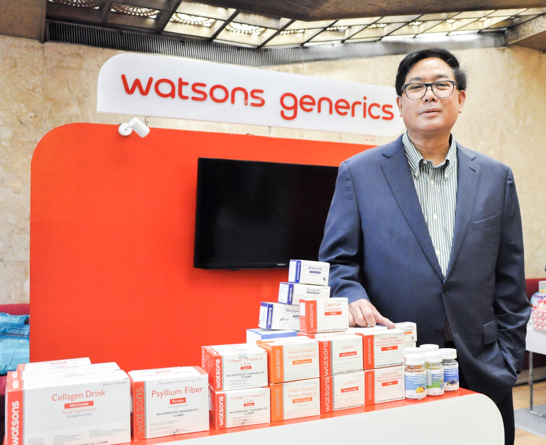 Danilo Chiong, Health Business Director of Watsons Philippines, showcases the brand's Generics line