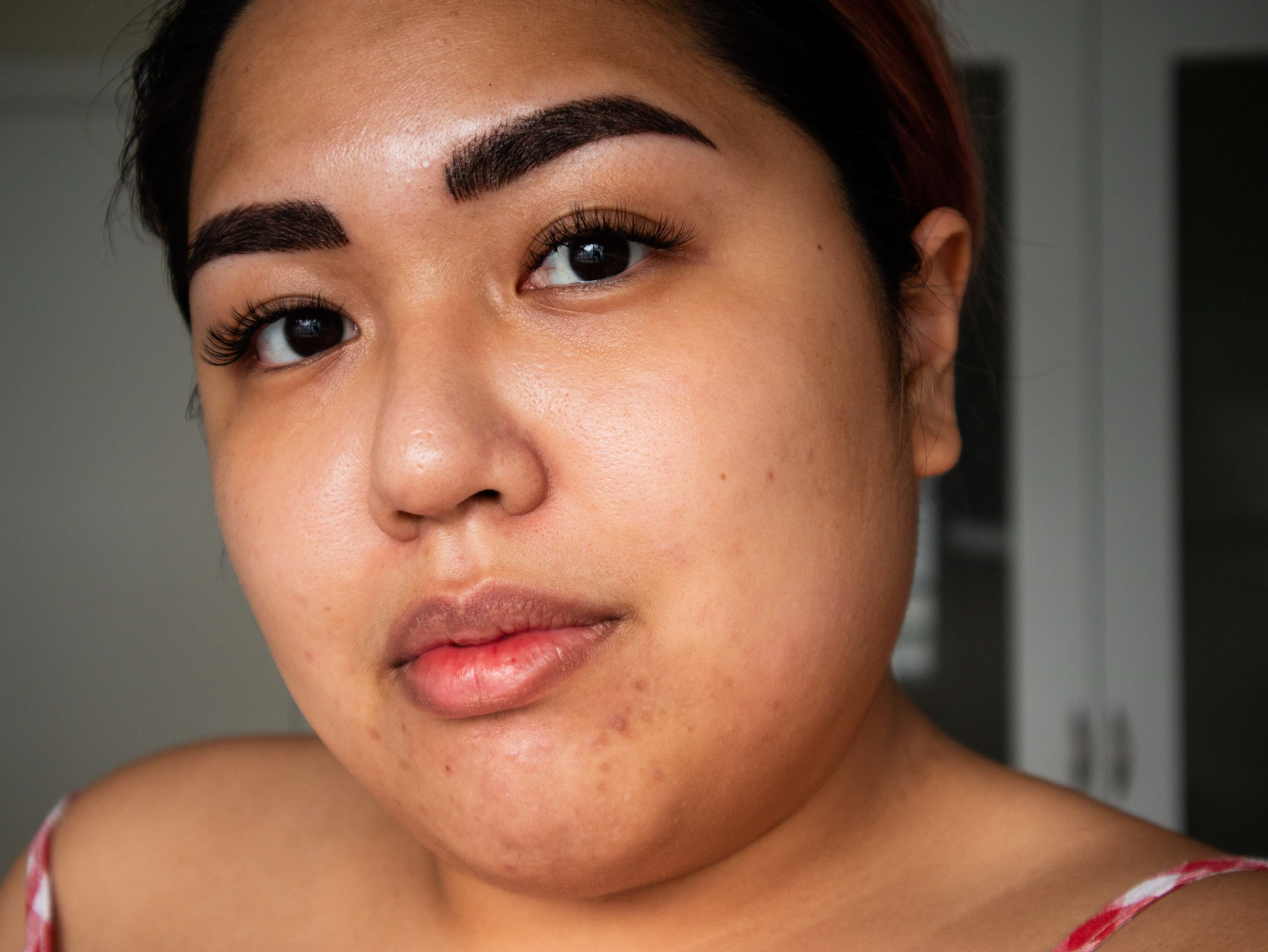 Bare faced with freshly-microbladed brows and new lash extensions