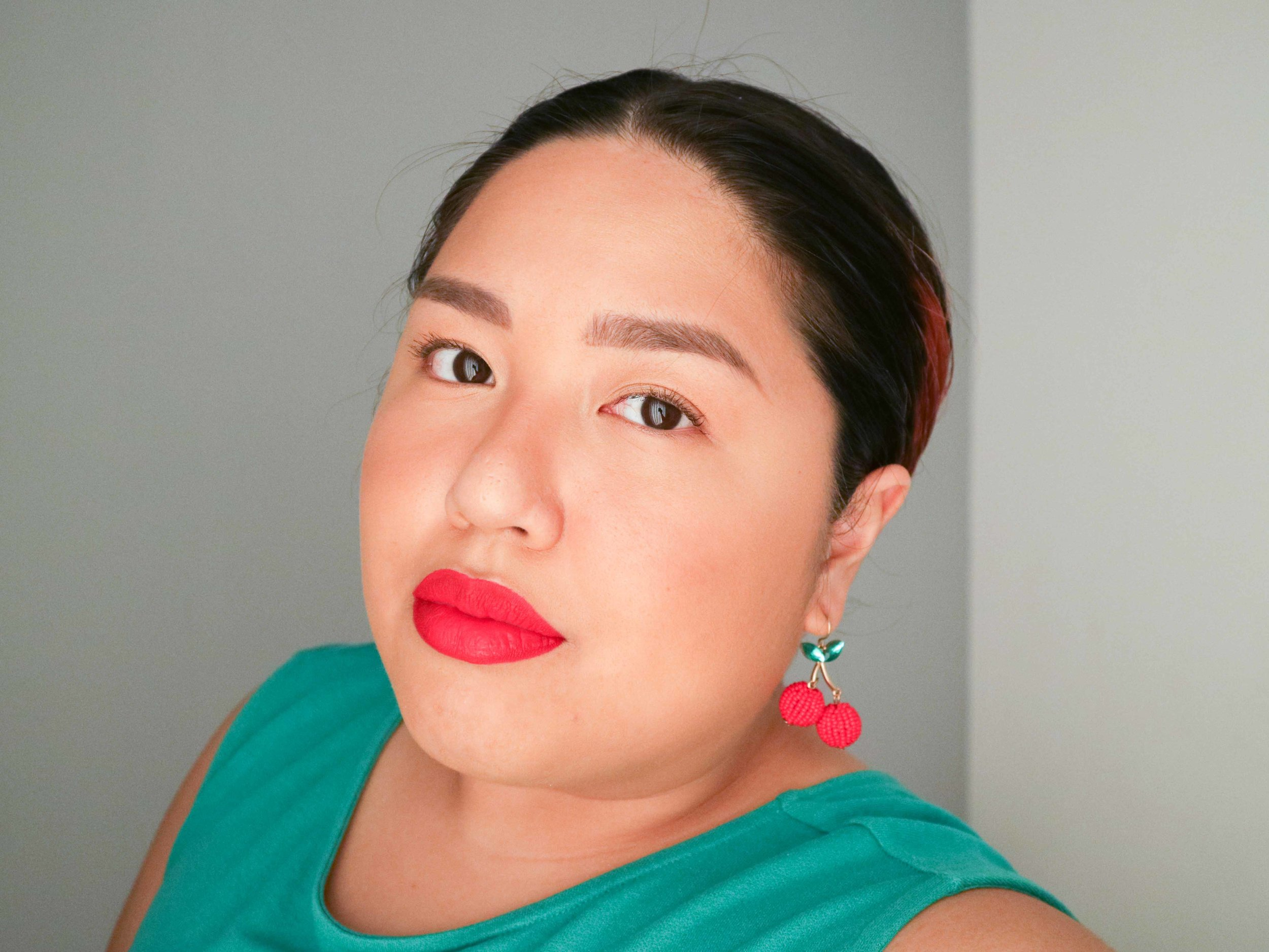 Cupid  is a lovely warm-toned red that brightens up my complexion. I used a lot of bronzer as blush to play up the warmth.
