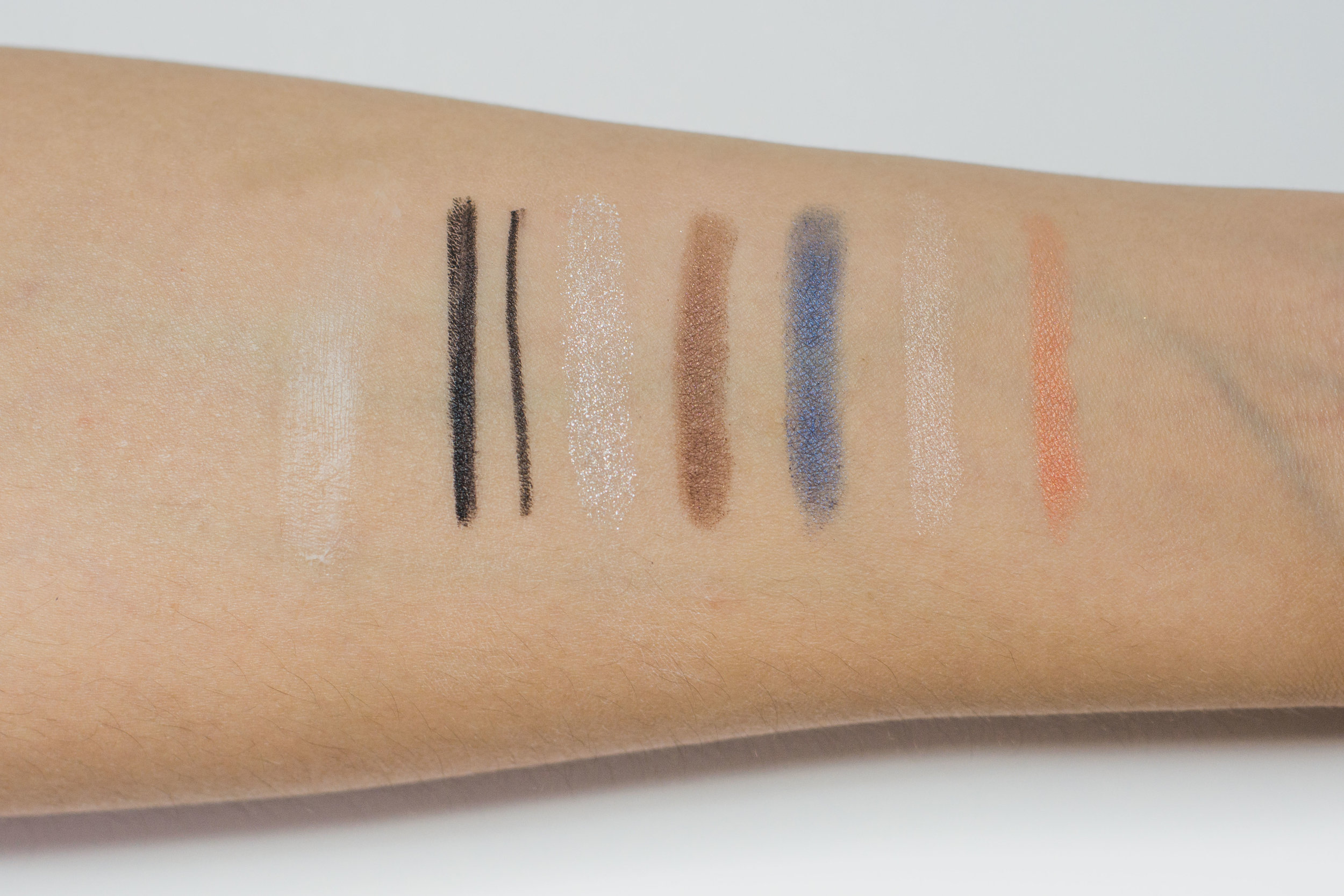 Swatches, from left: Lasting Multi Eyebase, Creamy Touch Liner in  01 Deep Black , and Perfect Styling Eyes #15