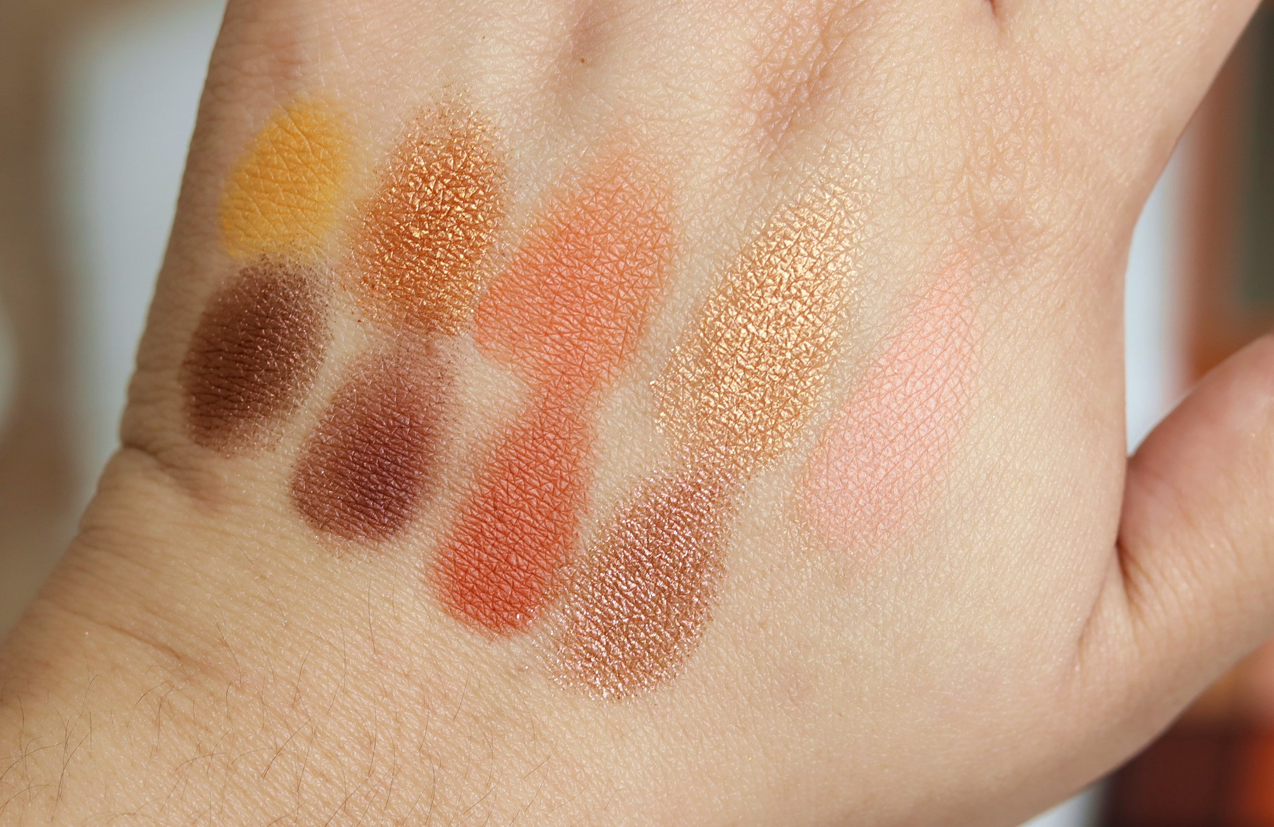 Swatches of   HUDA BEAUTY Obsessions Precious Stones Eyeshadow Palette in Topaz