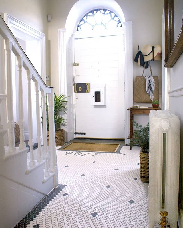 Entrance hall #beforeandafter lots of sleepless nights about flooring for this space. Timber or tile. Went with #mosaic tiles and added the year the house was built into it. Swipe to see. We replaced the rad with a cast iron one with decorative floral brass valves. Really love coming home to this space. . . . . . . . . . . #entrance #entrancehall #hallwaydecor #castironradiator #georgianrenovations #georgiandoor #mosaictiles #monochrome #hexagonal #restoration #periodproperty #georgianhouse #victorianterrace #georgianrenovation #georgianhome #antiquefurniture #renovationproject #salvagedfurniture #ironmongery #fanlight #fanlightfriday