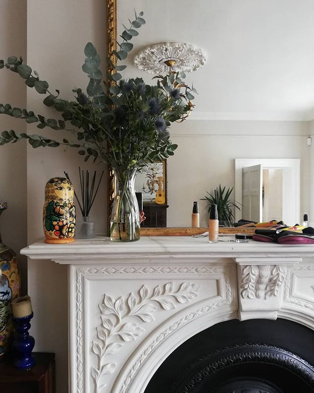 Getting serious mileage out of this eucalyptus 🌿 . . . . .. . . . . . . . . . . .  #antiquefurniture #marblefireplace #antiquemirror #goldmirror #restoredhome #georgianrenovations #georgianhome #townhouse #listedbuilding #ceilingrose #apartmenttherapy