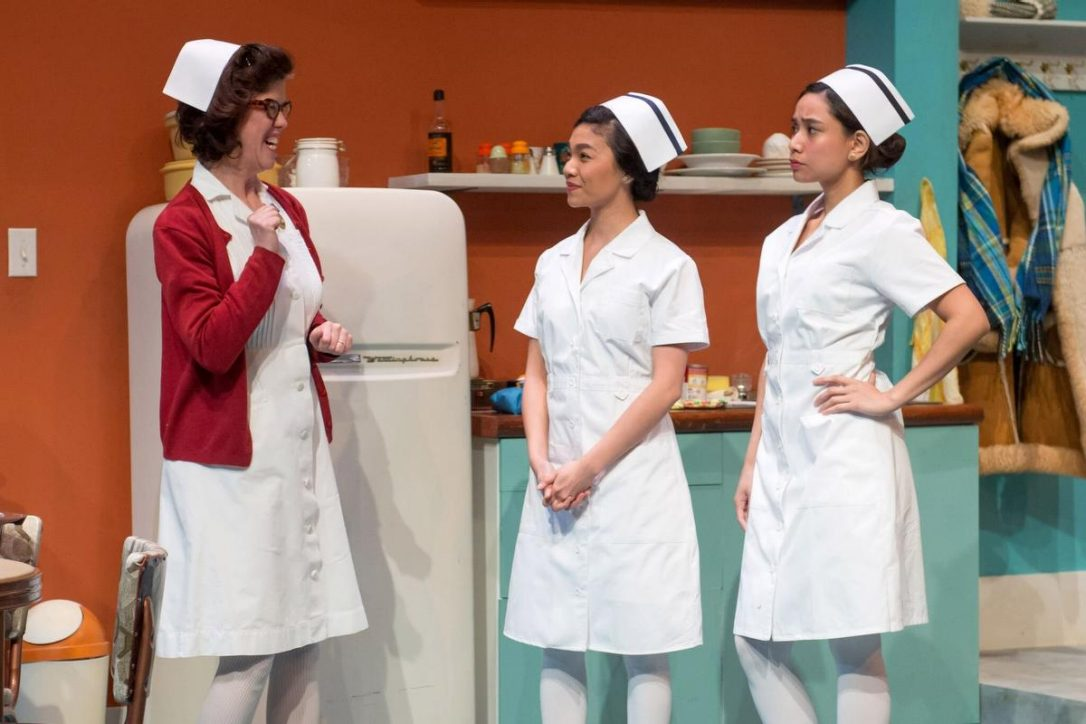 L to R: Catherine Fitch as Marie Anne Lussier, Belinda Corpuz as Puring Saberon and Isabel Kanaan as Penny Uy. Set Design by Jung-Hye Kim, Costume Design by Anna Treusch, Lighting Design by Jareth Li. Image credit: Josephy Michael Photography.