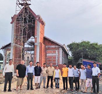 New church building and the construction crew.