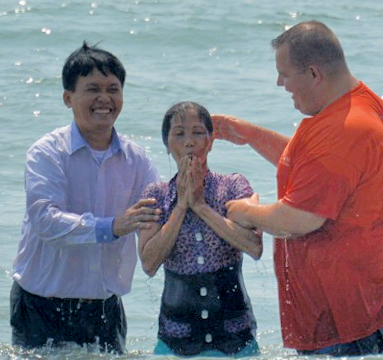 Baptizing in the ocean