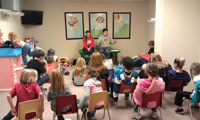 Braden and Carter Demark teaching Bible lessons to Recovery kids at Potters House