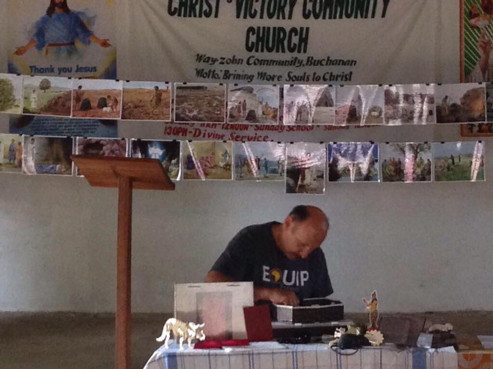 Herb Baker, a pastor from Missouri putting together all the props for the lessons.