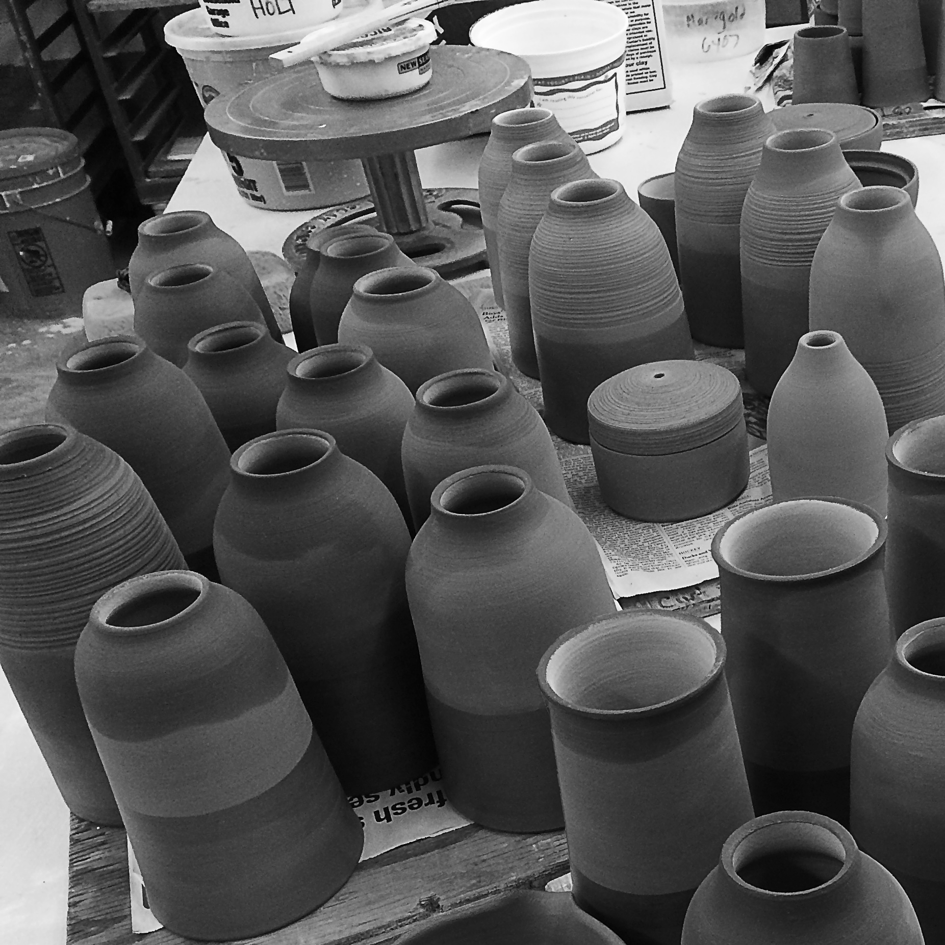 Pieces are fired in the kiln, sanded to smooth the bottom, cleaned and then glazed.