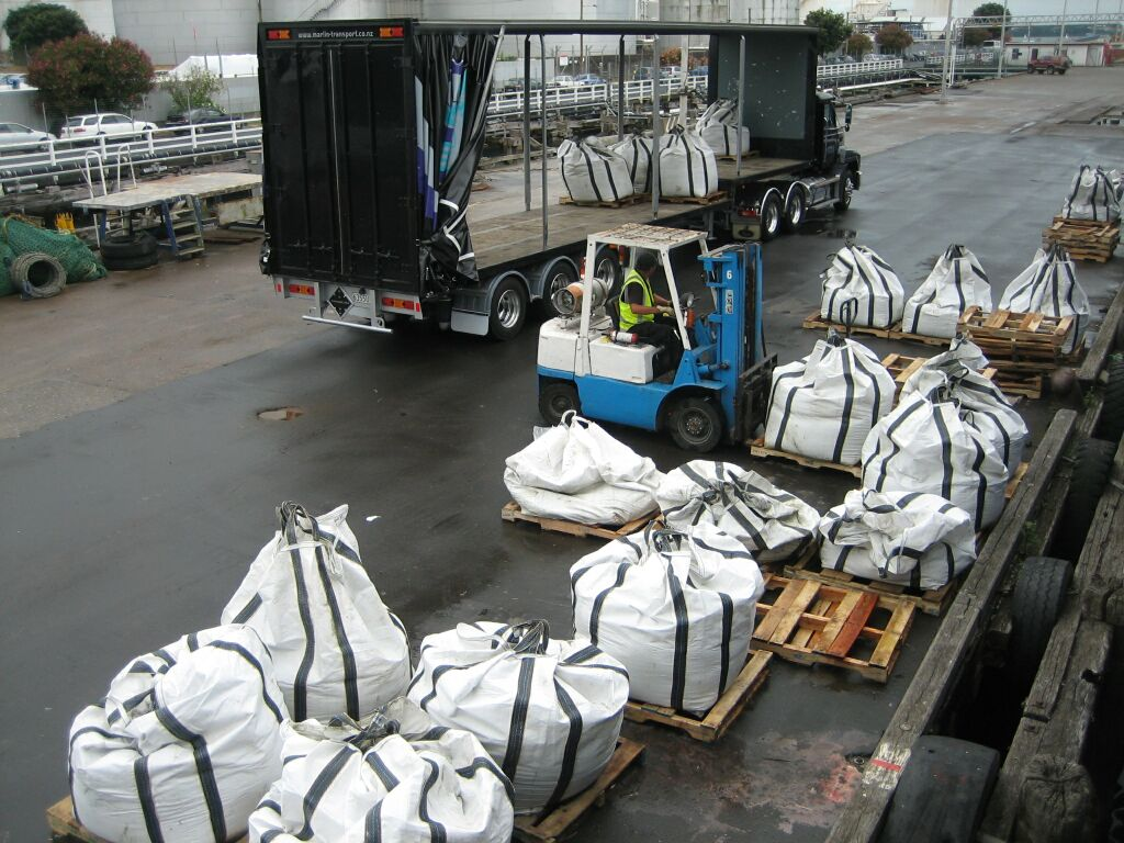 large_sample_bags_being_lifted_into_truck_for_transport_to_warehouse1.jpg