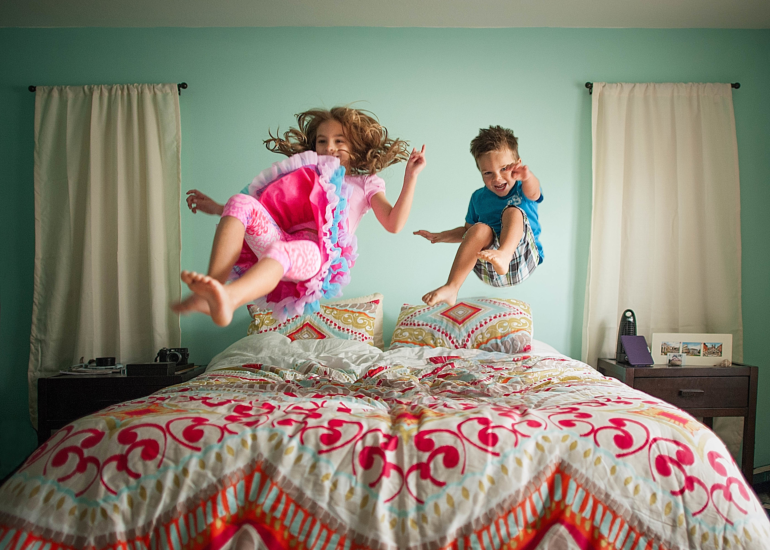 My kiddos, jumping on the bed.