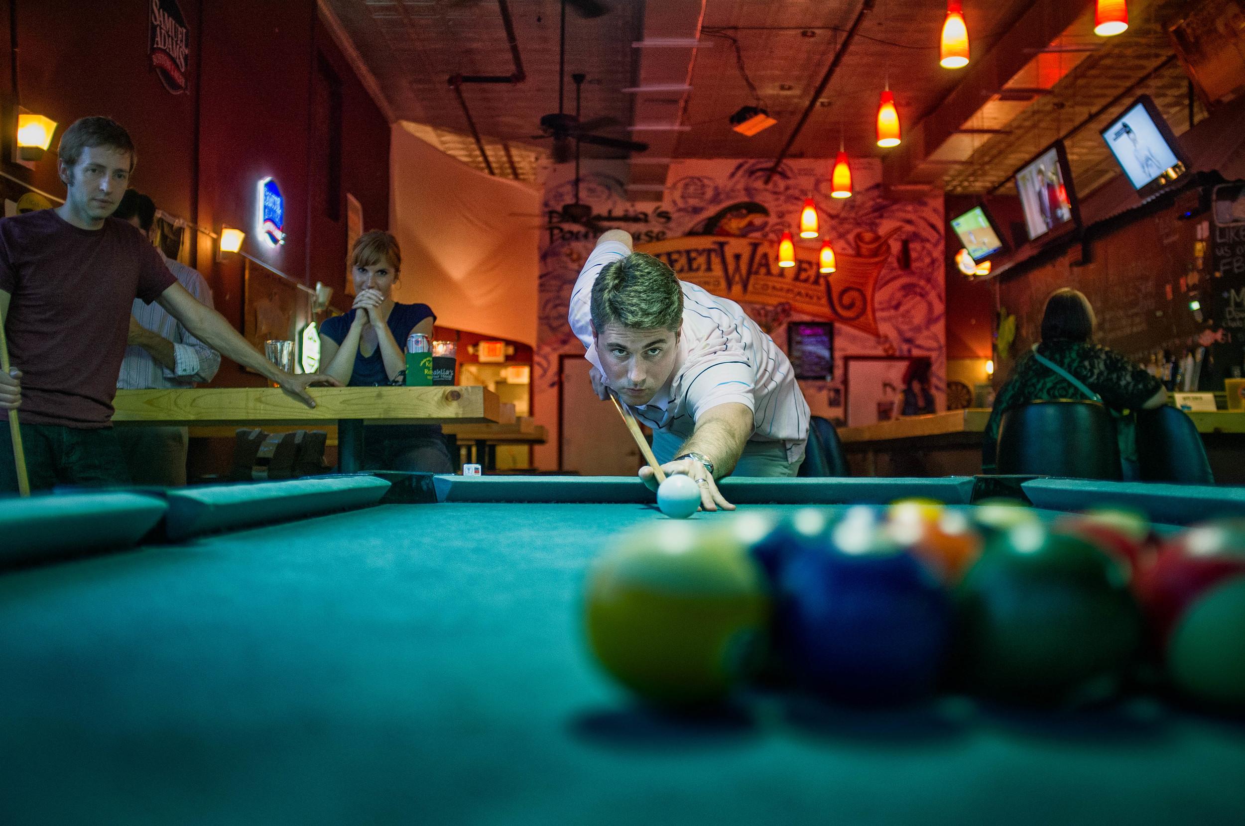 Kip, focused on playing pool.