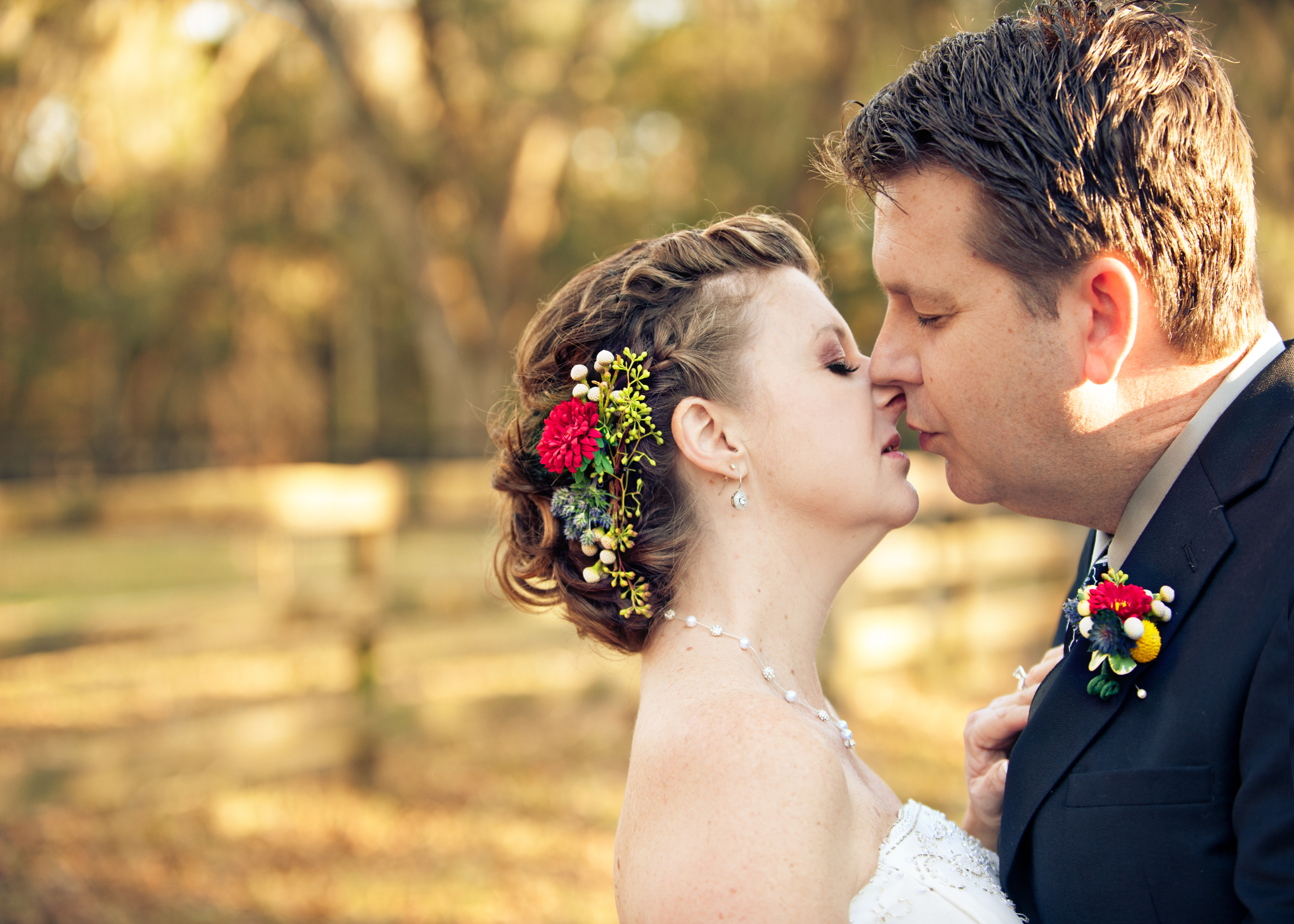 Bride and Groom kiss during their ceremony at their rural ceremony in Florida.jpg