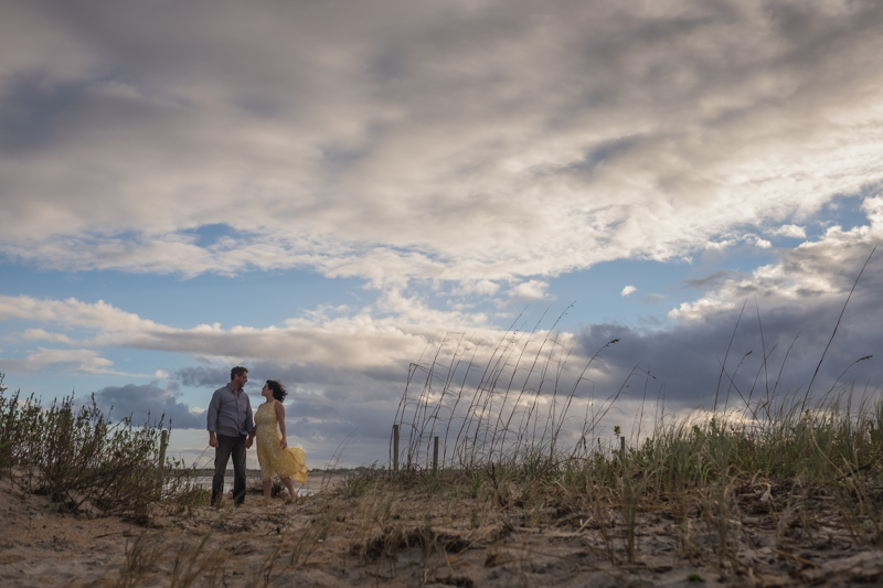 Heather and Greg hold hands at Vilano Beach engagement shoot