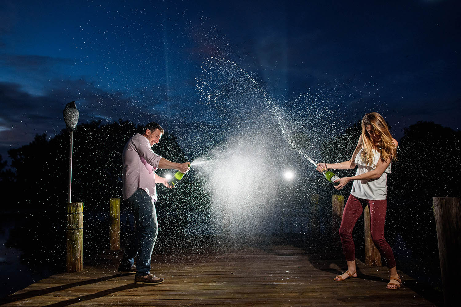 bride-and-groom-celebrate-engagement-with-champagne