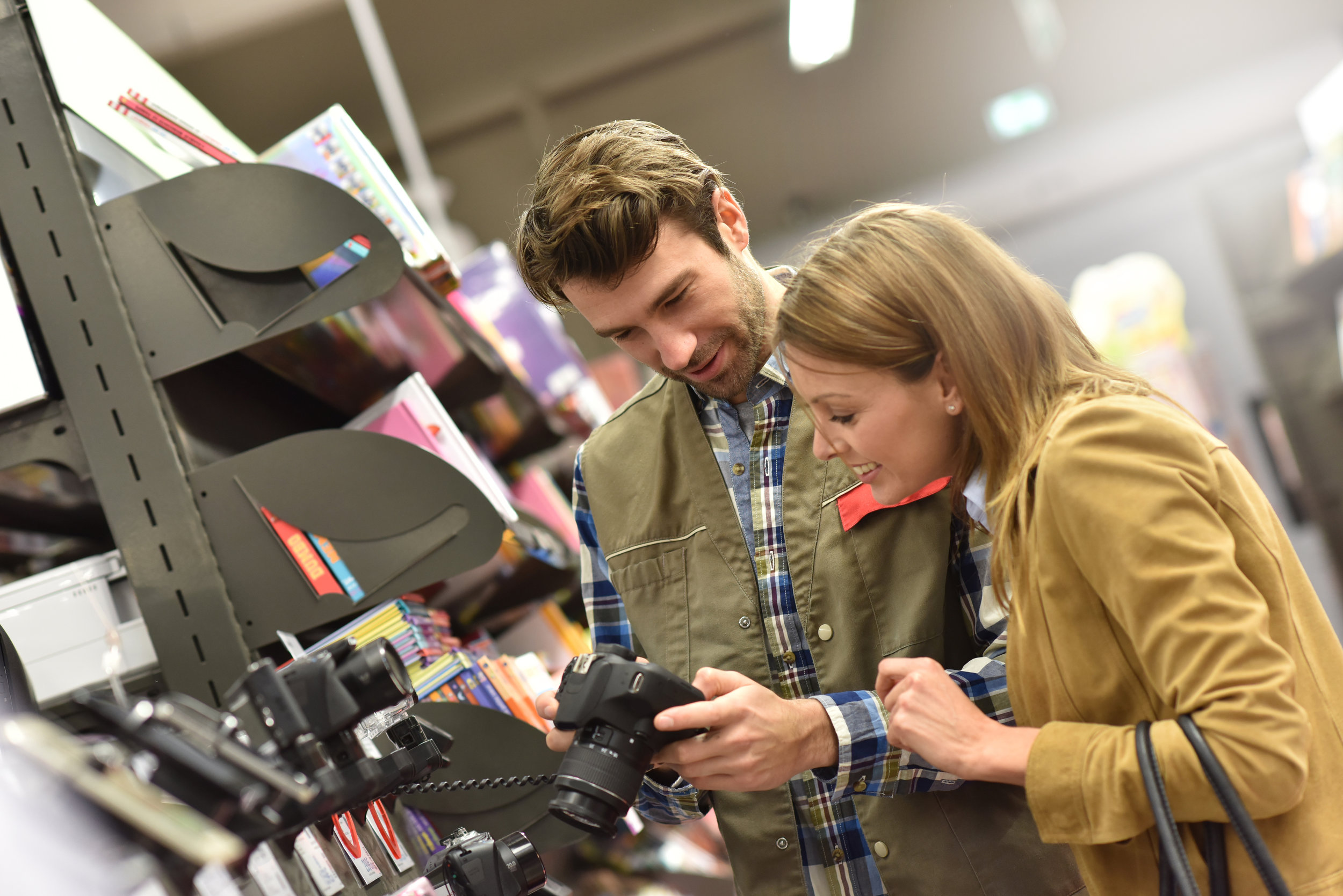 woman looking at camera with clerk