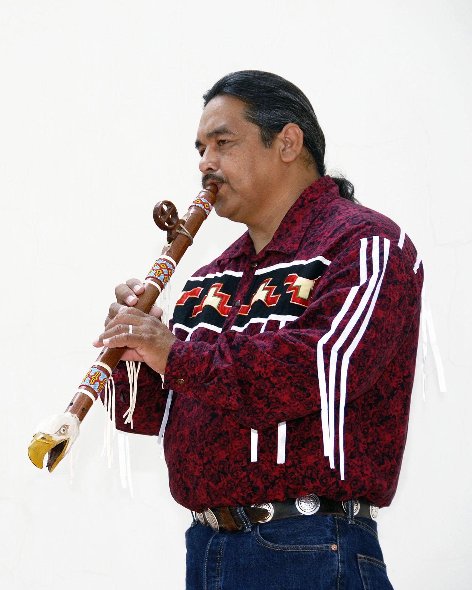 Alex Maldonado plays a hand-carved eagle flute.