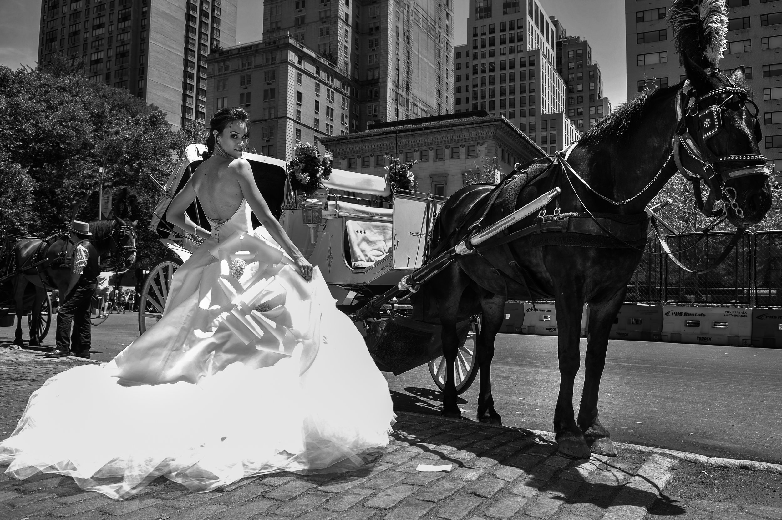 NEW YORK - June 13: Model Kalyn Hemphill pose in front of horse carriage at the Irina Shabayeva SS 2016 Bridal collection photoshoot on June 13, 2015 in New York, USA