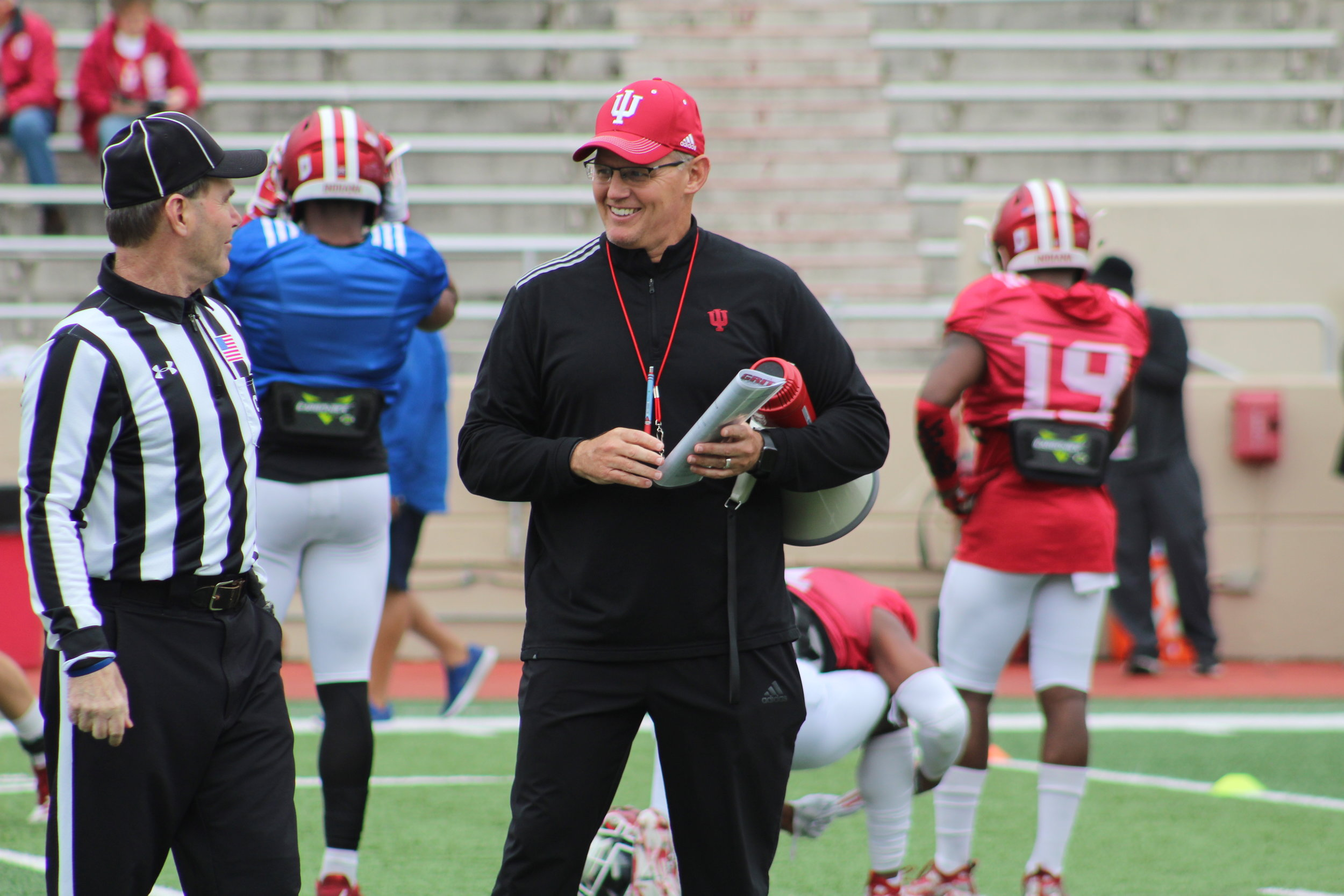 Tom Allen speaks to an official prior to Indiana's 12th spring practice  Image: Hoosier Huddle