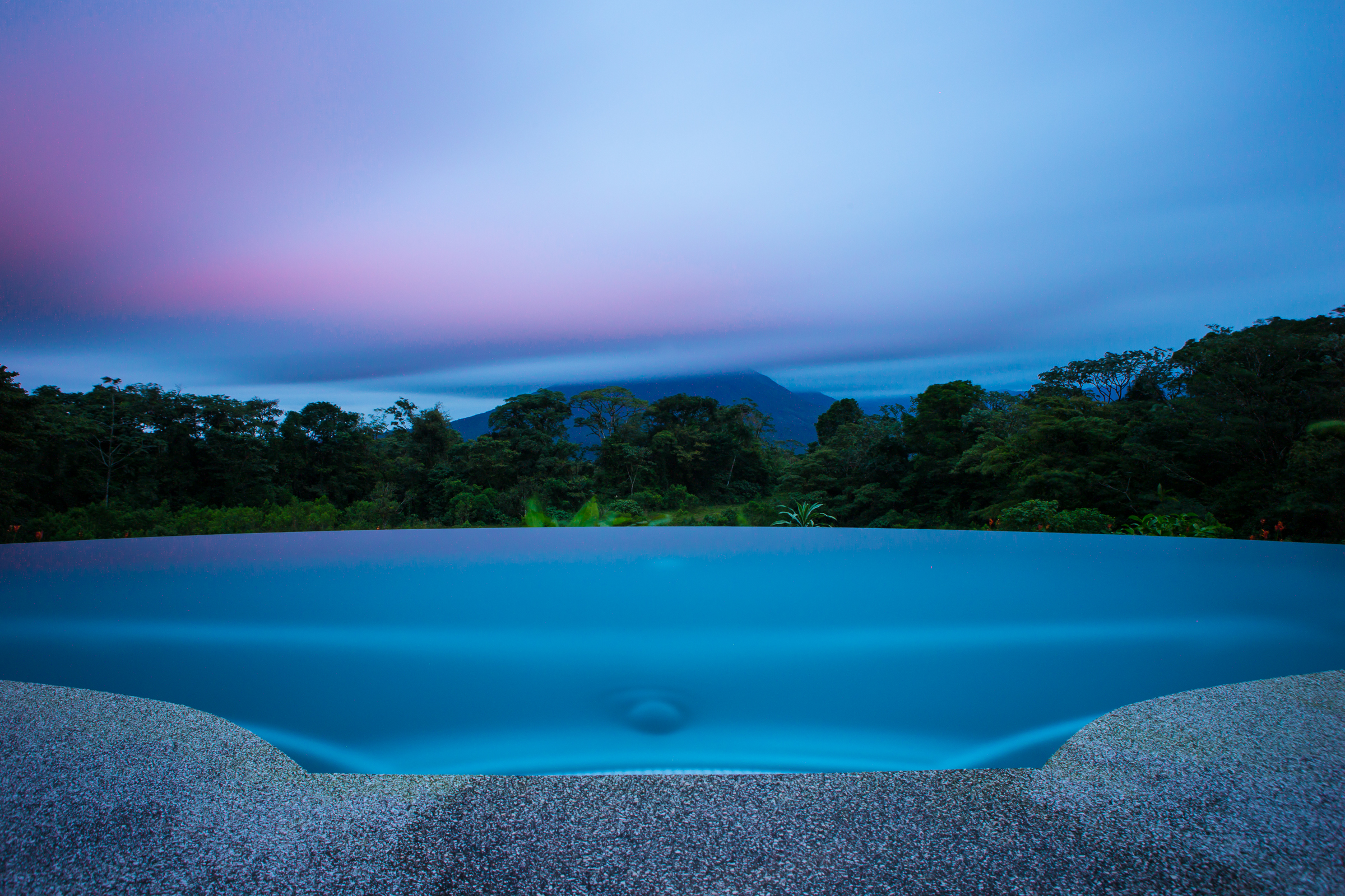 A long exposure at sunset, clouds now covering most of Arenal Volcano.