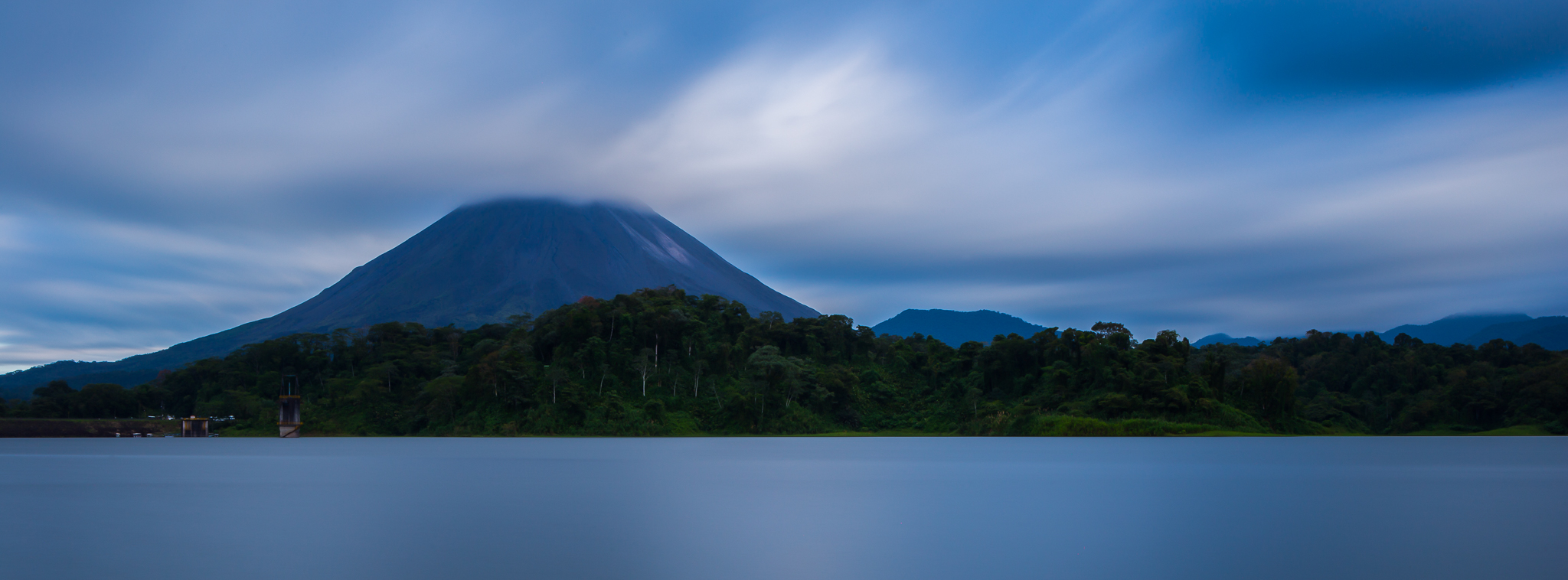Lake Arenal-I used a Lee Big Stopper to create a long exposure during the day. This creates the glassy water effect and blurs the motion of the clouds.