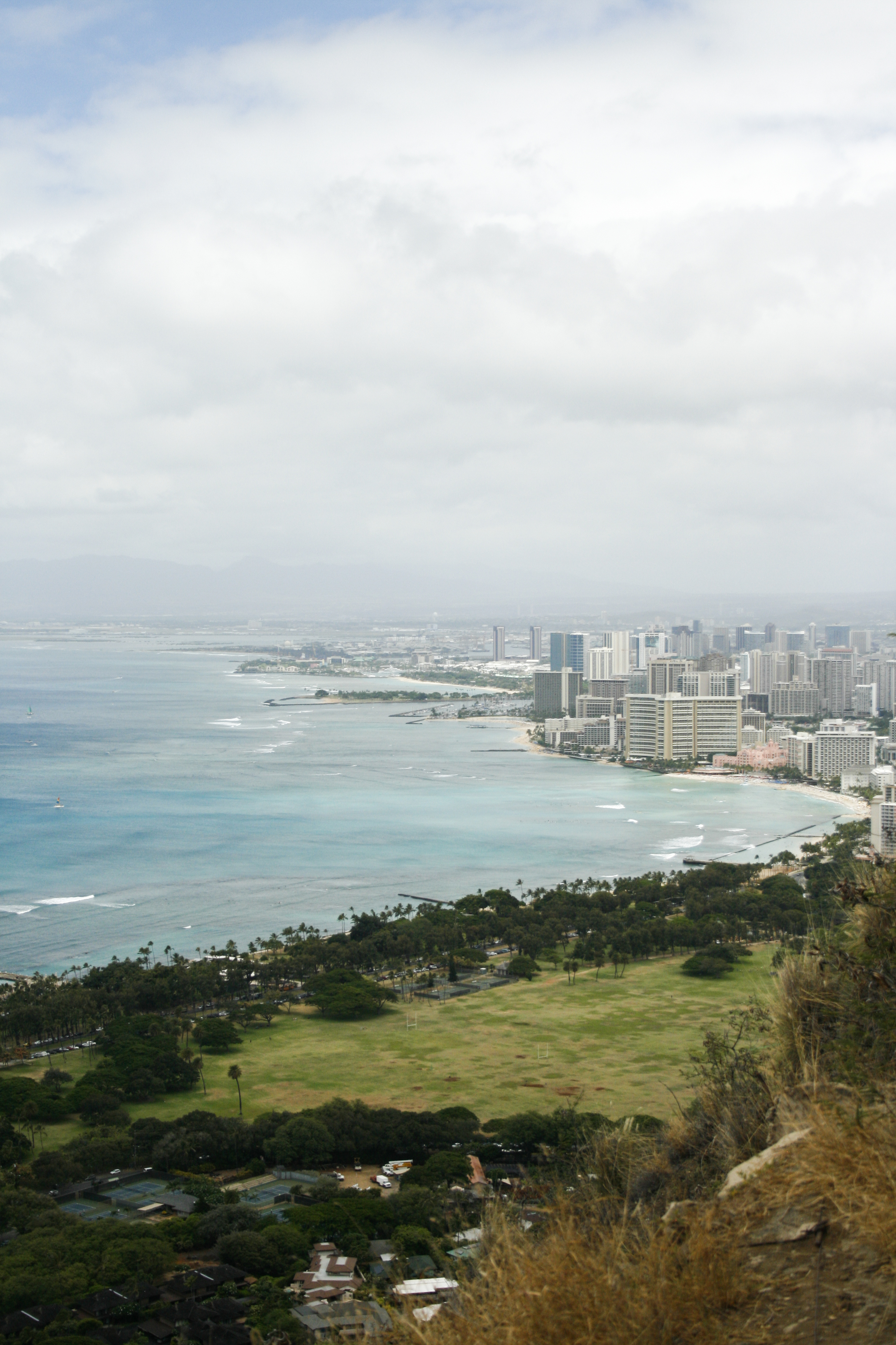 The view of Waikiki Beach from the top of Diamond Head Crater. You can vaguely see our hotel to the right of the pink hotel. It was once an active volcano!