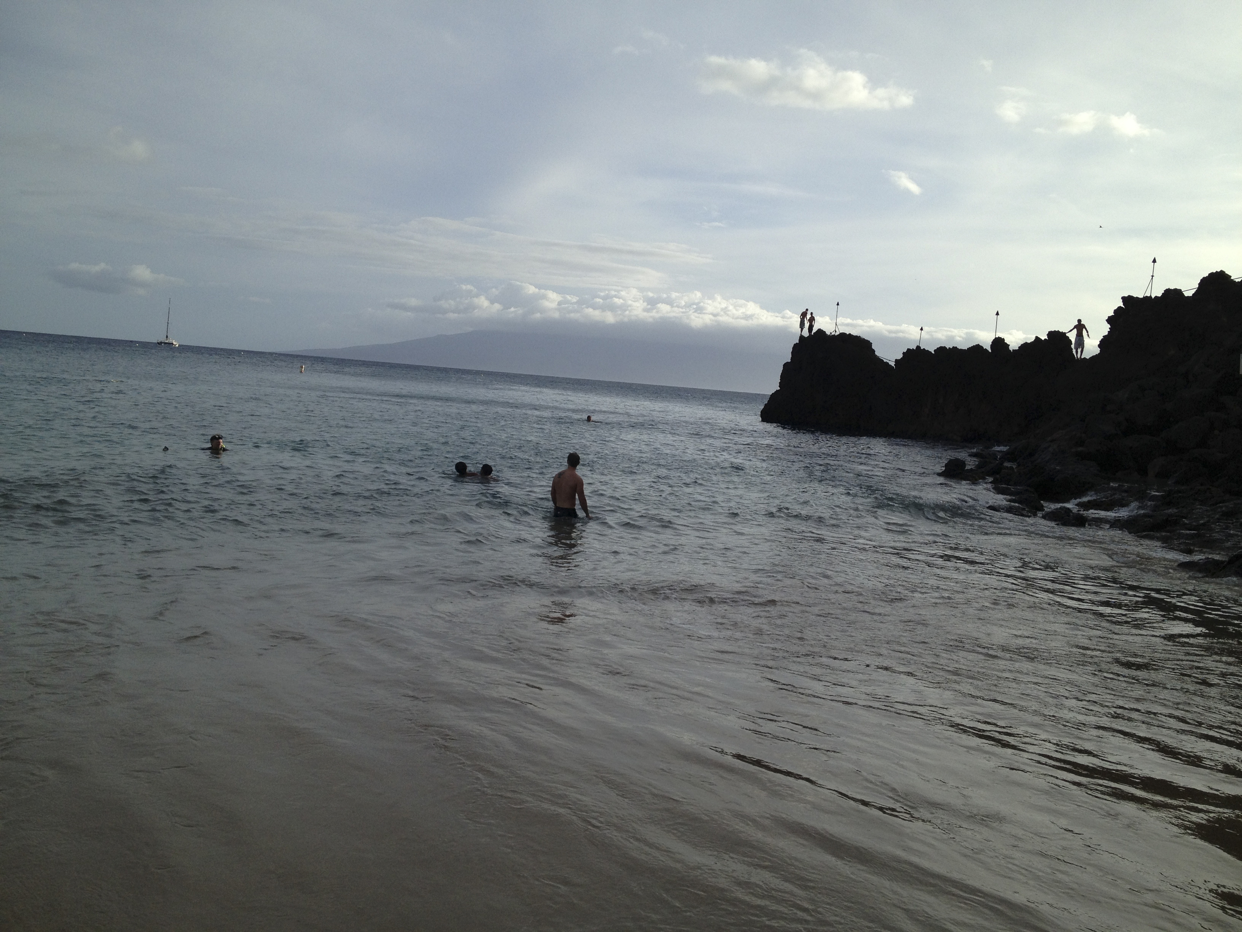 Black Rock; My husband is on the edge ready to jump into the water.