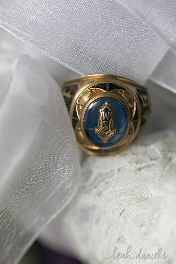 The bride had her father's high-school ring attached to her bouquet to keep him with her all day.