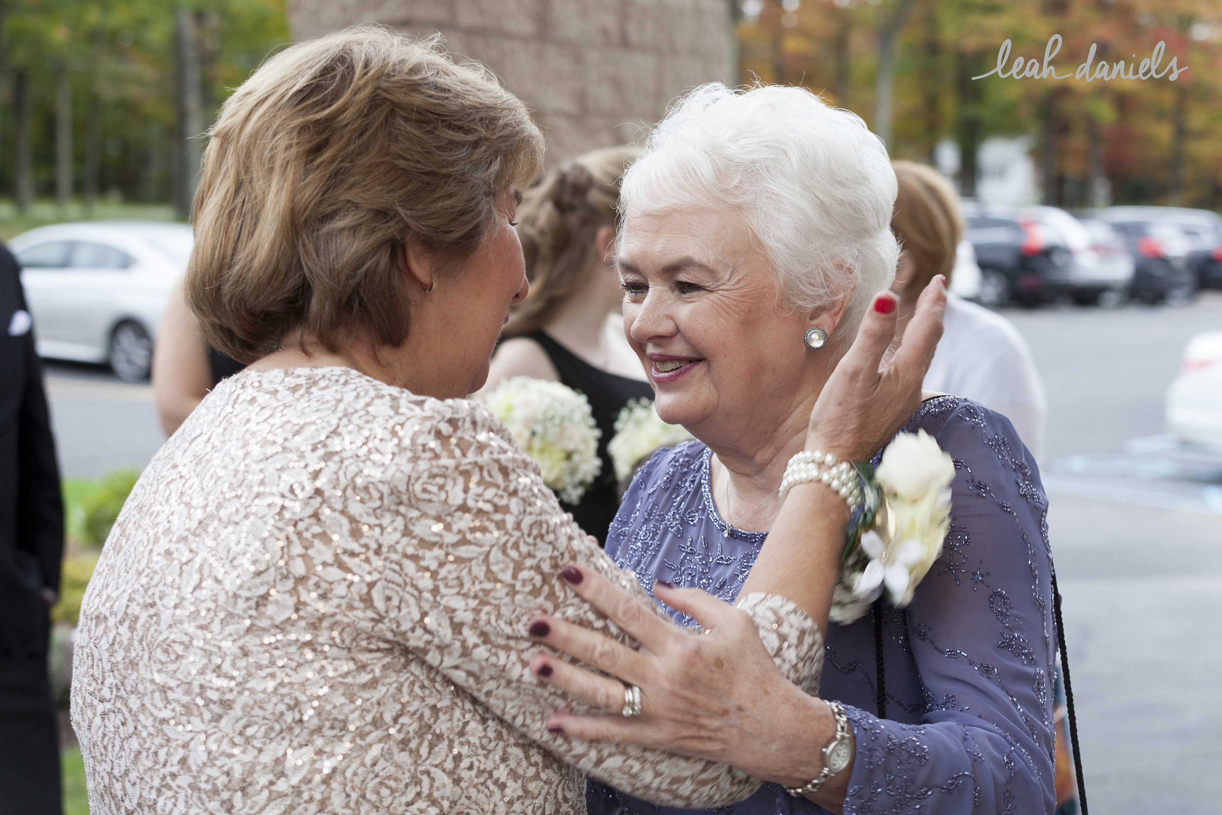 An absolutely beautiful moment between the Bride and Groom's Mothers <3