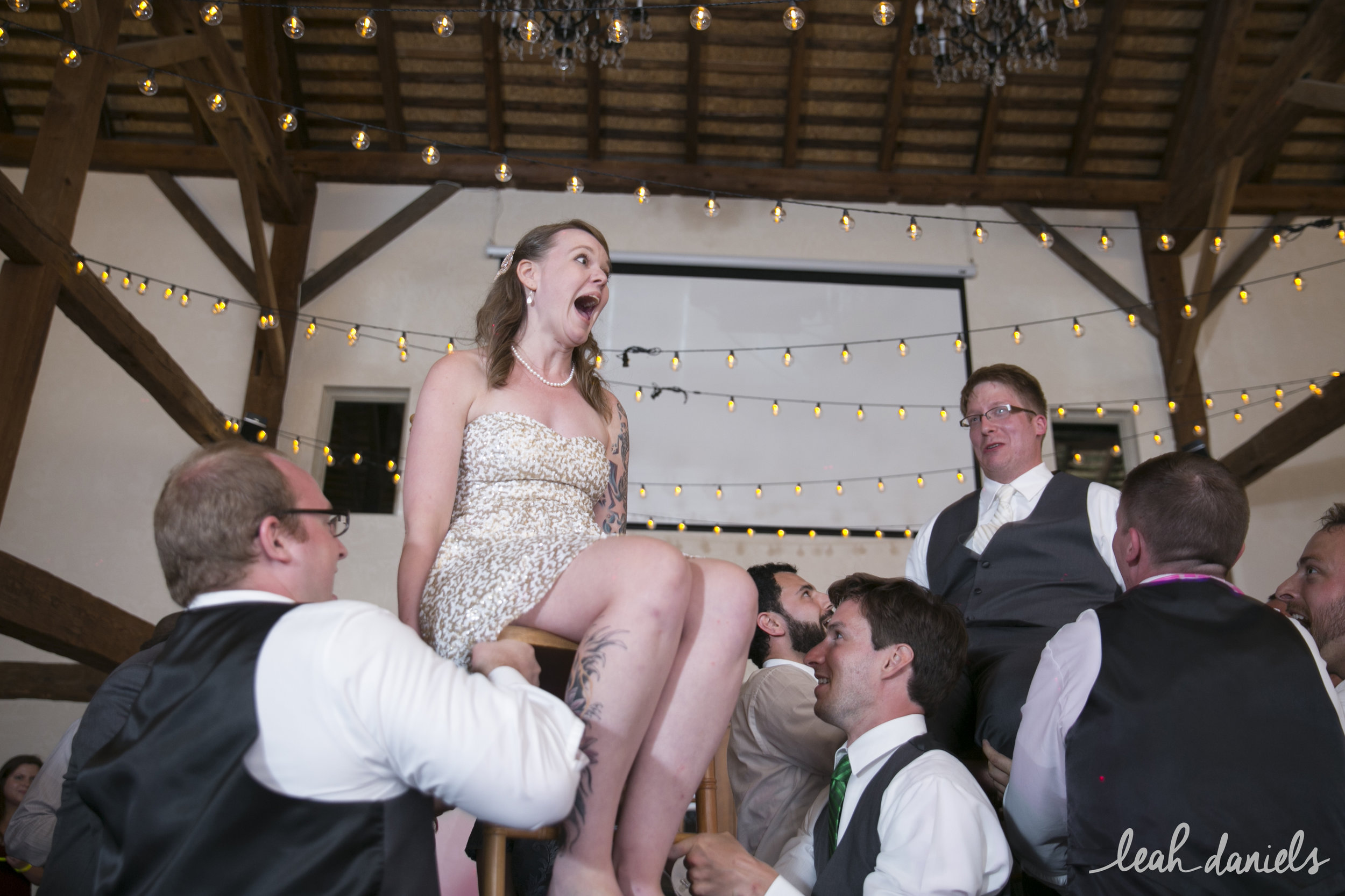 Tiffany and Sasha holding on tight to their chairs during the Hora!