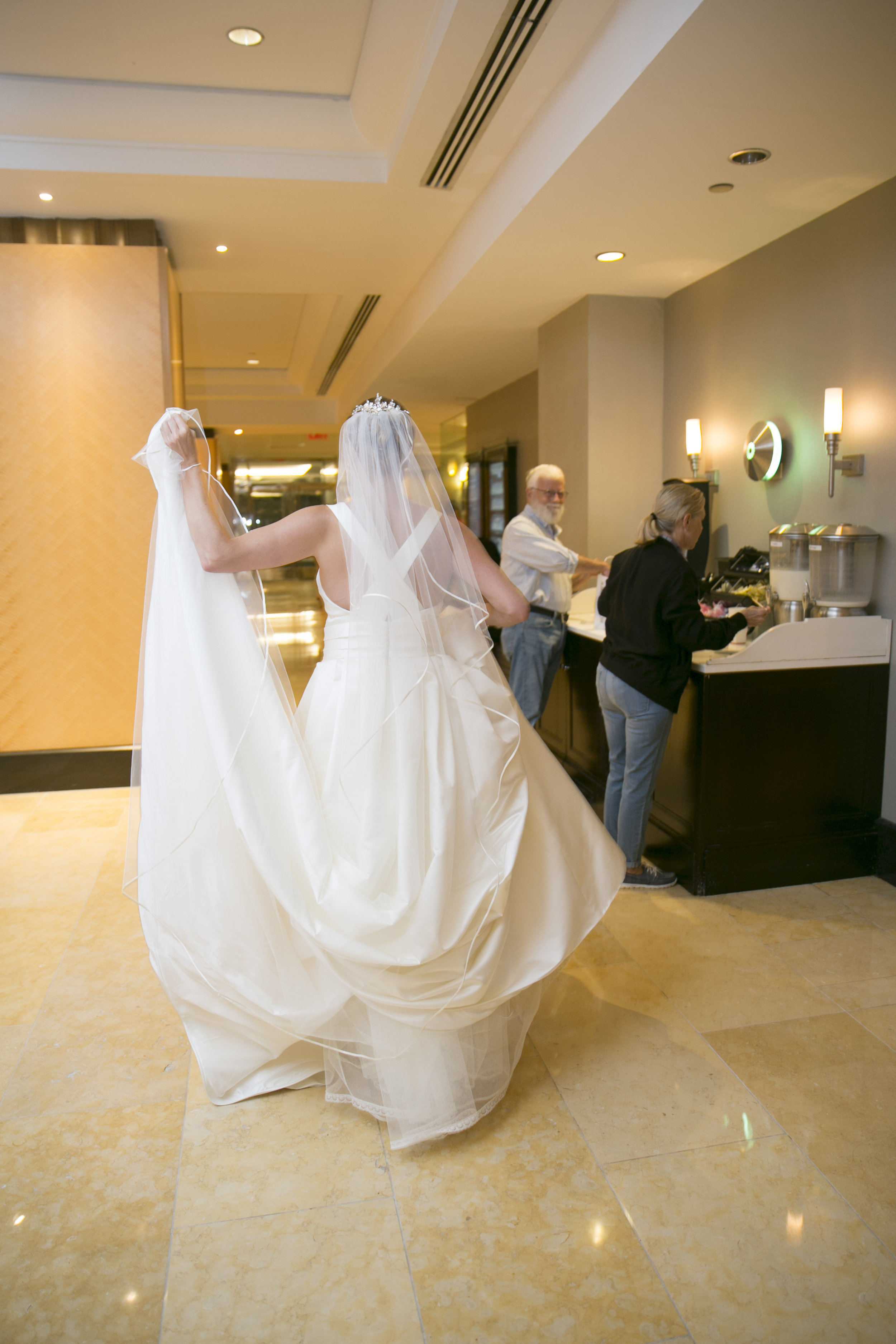 The moment when you walk through the hotel lobby in your wedding dress and everyone stops and stares.