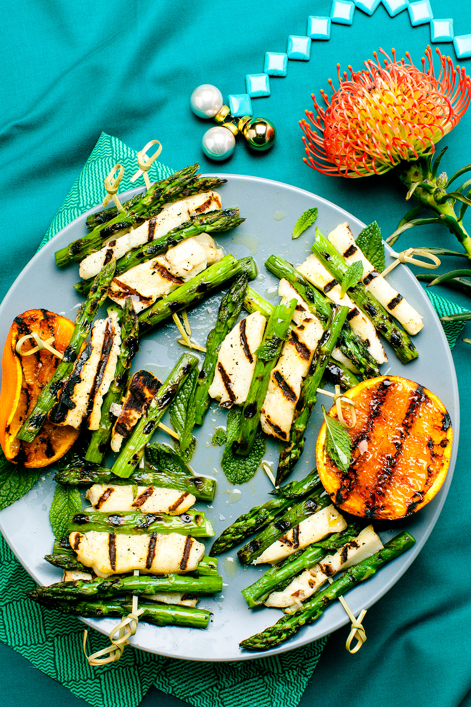 Grilled Haloumi and Asparagus with Orange & Mint ,   appeared originally in   Yum. Gluten Free Magazine   Dec Issue.   Recipe and styling by   Cle-ann  , photo by   Hugh Adams  .