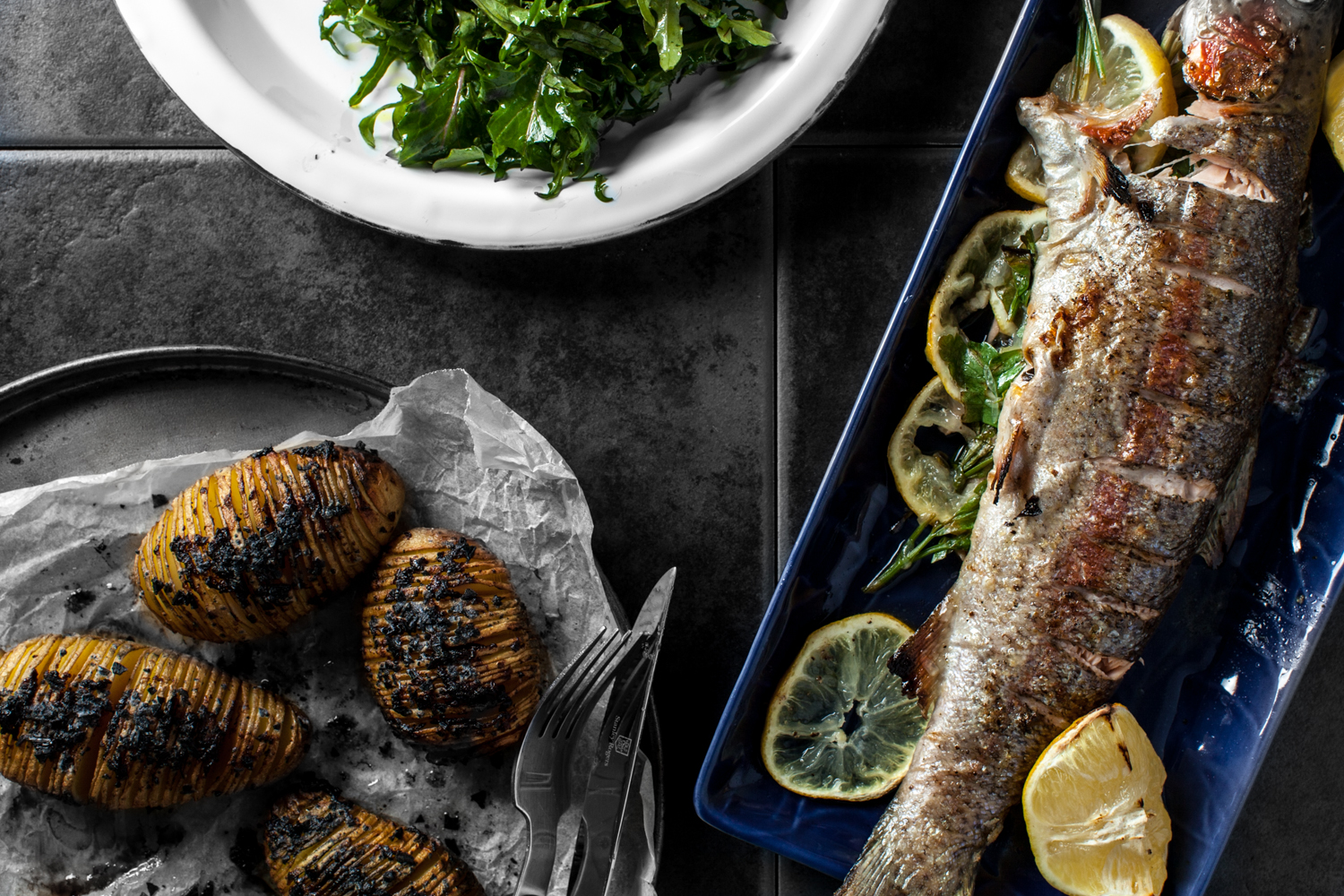 Grilled Rainbow Trout Dinner for Two. Hasselback Potatoes, Rocket Salad and Grilled Rainbow Trout.  Recipe and styling by   Cle-ann  , photo by   Hugh Adams  .