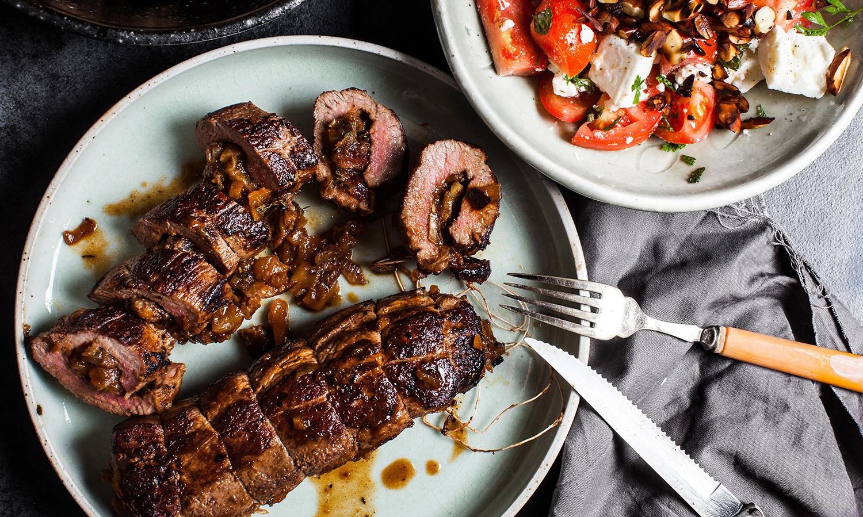 Date & Apricot Stuffed Lamb Backstrap w Tomato, Almond Salad.Recipe and styling by  Cle-ann , photo by  Hugh Adams .