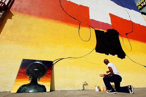 "Patrick Johnson working on a mural titled ""Elixir"" at the Liquor Bank. Photo by Mel Melcon/Los Angeles Times."