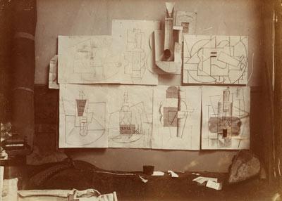 Pablo Picasso,  Installation in the artist's studio at 242, boulevard Raspail , Paris, December 9, 1912, or later, Gelatin silver print, 3 3/8 x 4 1/2″