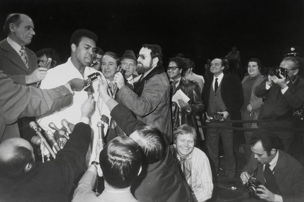 Garry Winogrand    Muhammed Ali - Oscar Bonavena Press Conference, New York  1970 gelatin silver print 14 x 17 inches (35.6 x 43.2 cm)   estate stamped by executor of Winogrand estate