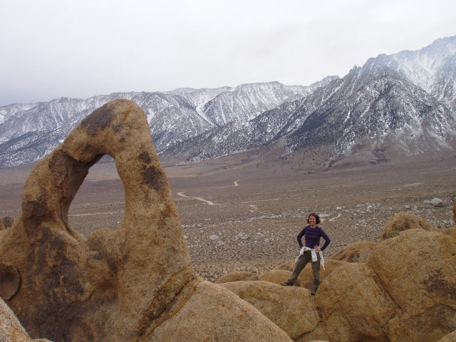 Kristine next to an arch in the Alabama Hills