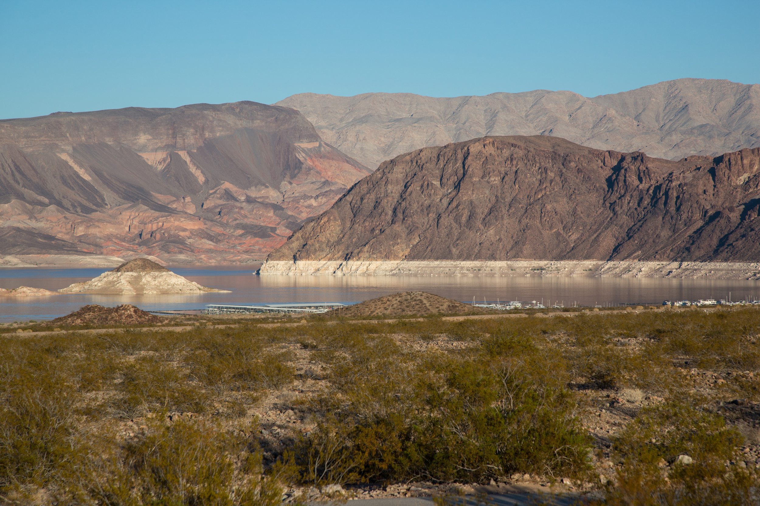 """The """"bathtub ring"""" at Lake Mead near Henderson, Nevada is a symbol of the devastating drought in the U.S. Southwest. The bathtub ring is white because of the deposition of minerals on previously submerged surfaces."""