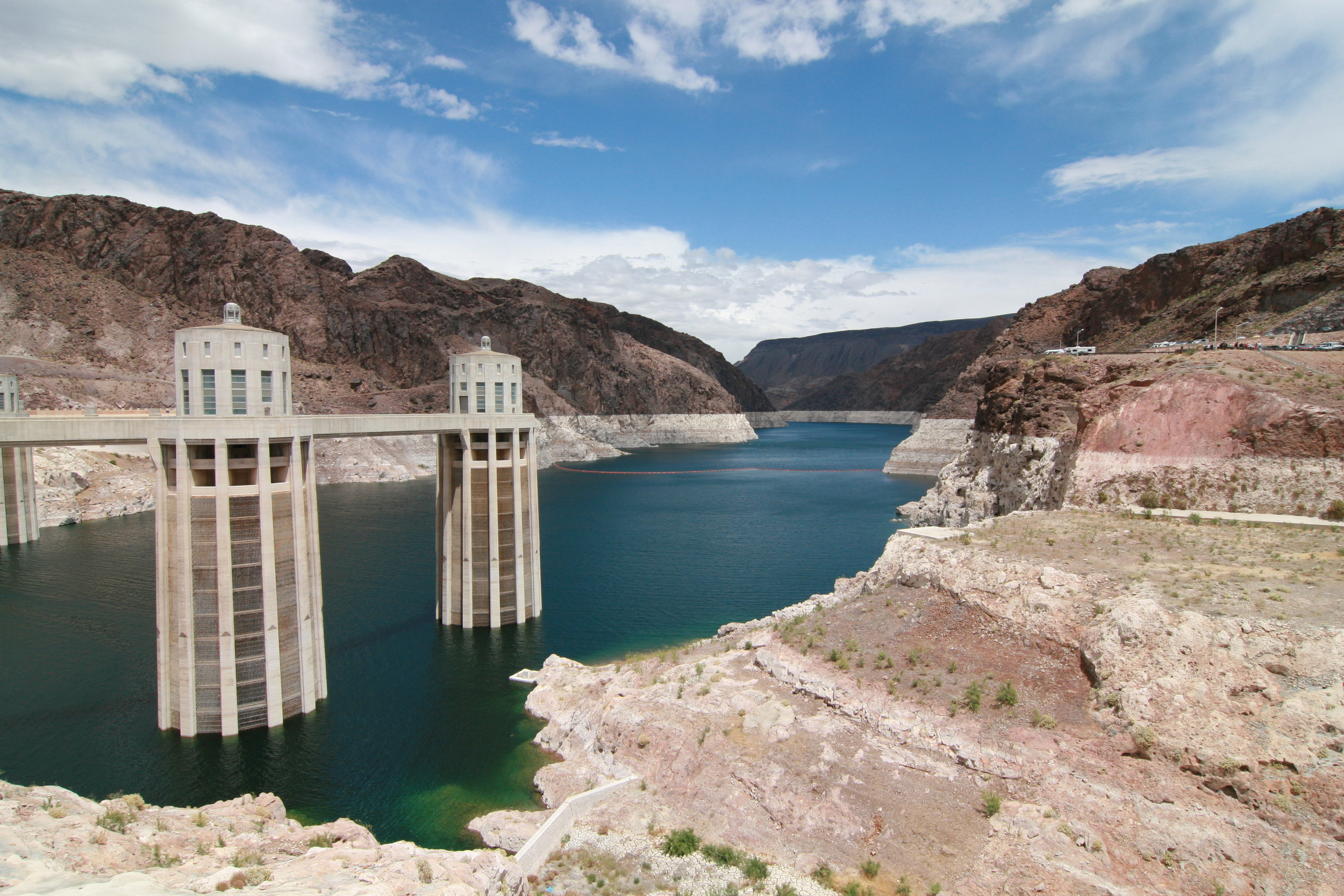 """The """"bathtub ring"""" around Lake Mead at Hoover Dam near Henderson, Nevada is a symbol of the devastating drought in the U.S. Southwest. The bathtub ring is white because of the deposition of minerals on previously submerged surfaces."""
