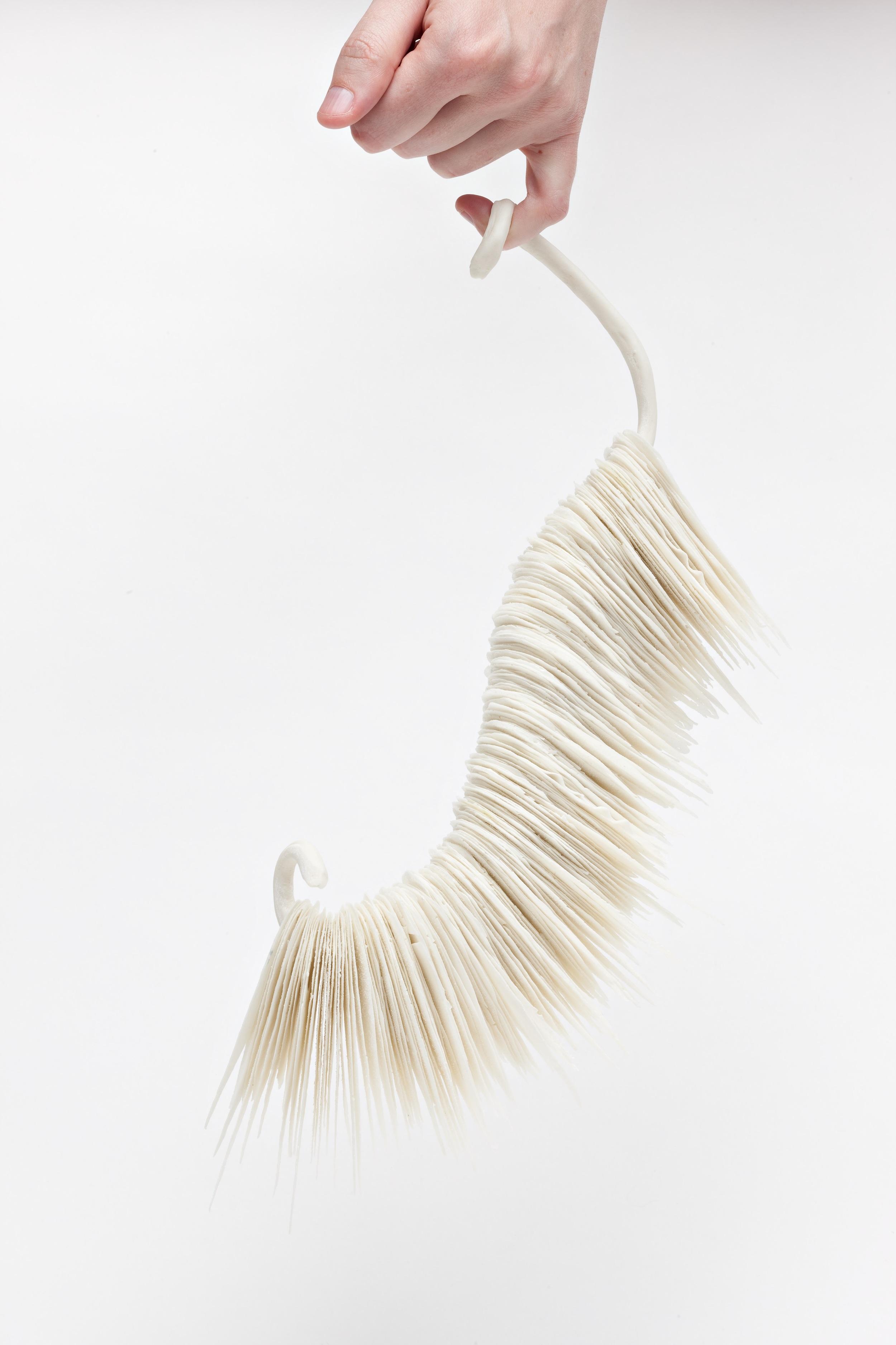 Suspension,  2008, artist blend glaze material, 28cm x 15cm x 10cm