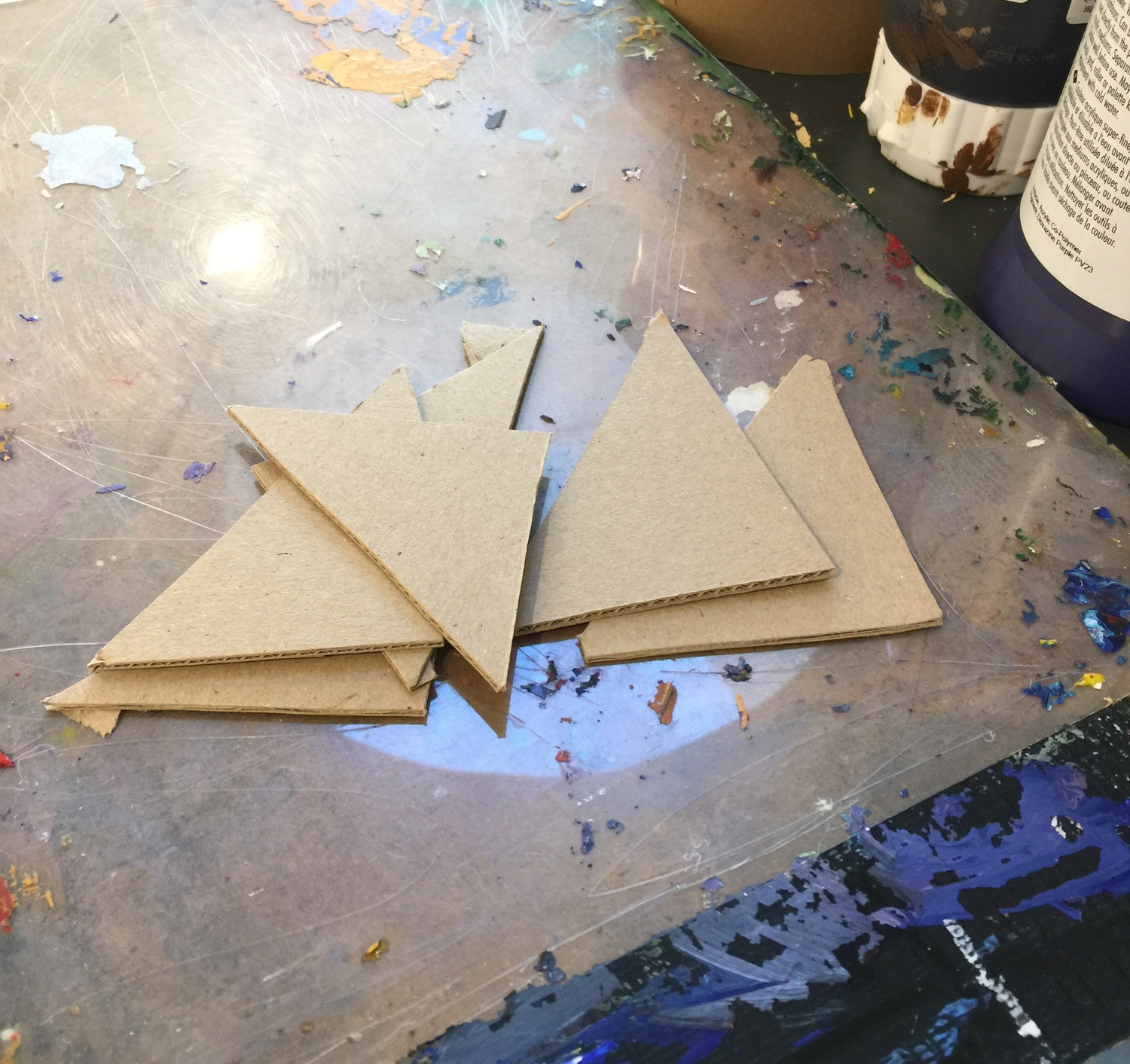 Cardboard wedges used to scrape paint on in block sections