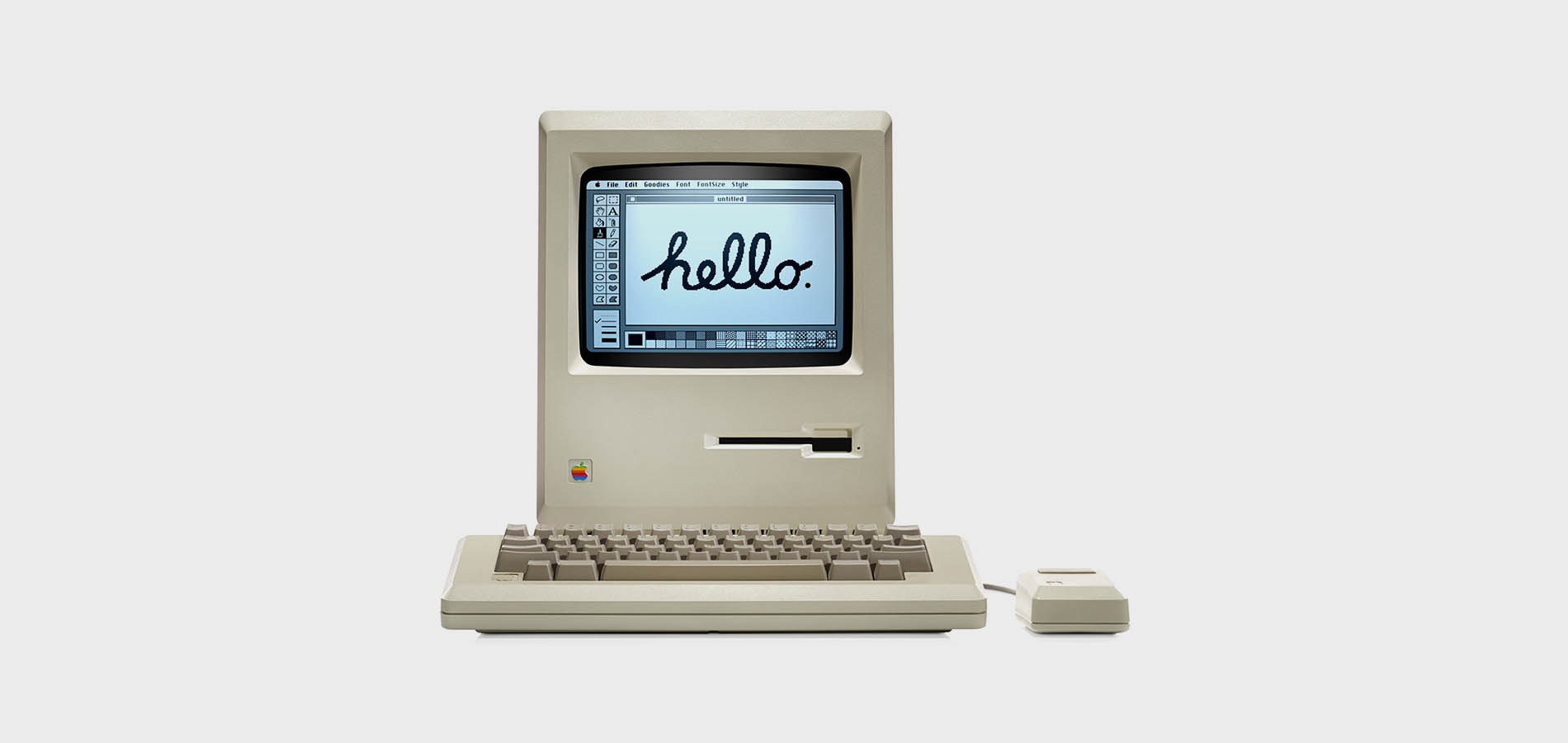 The original Macintosh in 1984 featuring Kare's user interface and 'Hello' illustration.